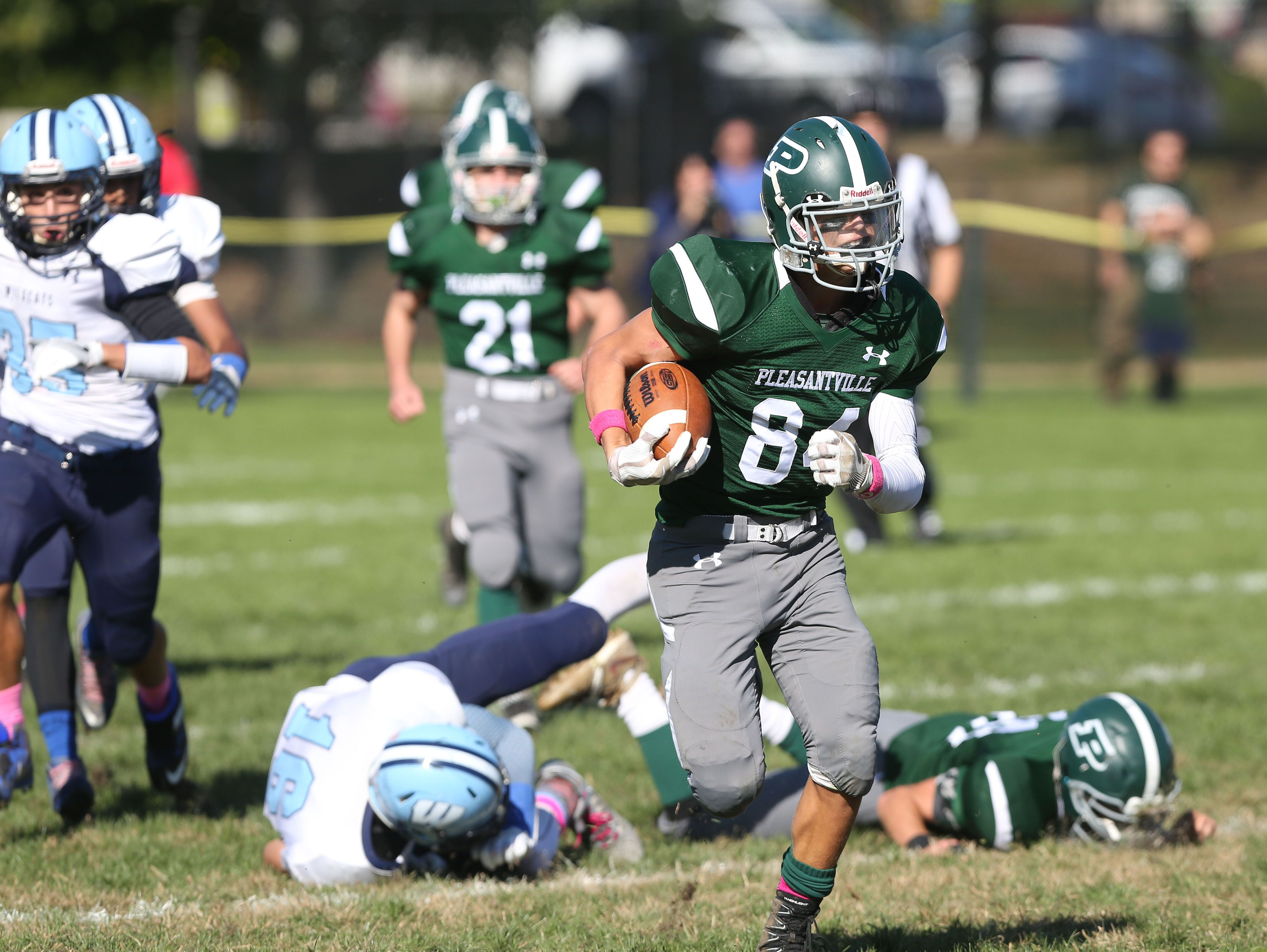 Pleasantville's Ryan Drillock (84) runs for a first half touchdown against Westlake during football action at Parkway Field in Pleasantville Oct. 15, 2016. Pleasantville won the game 38-35.