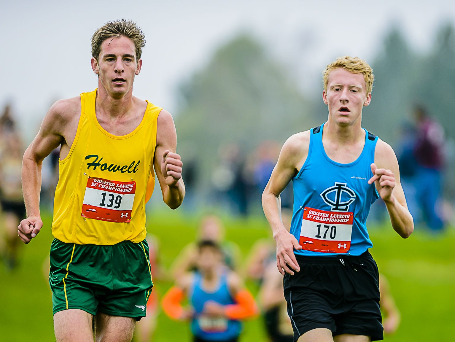 Lee Owens ,139, of Howell and Ethan Markey ,170, of Lansing Catholic pace each other during the Greater Lansing Cross Country championships Saturday October 15, 2016 at Ledge Meadows Golf Course in Grand Ledge. KEVIN W. FOWLER PHOTO