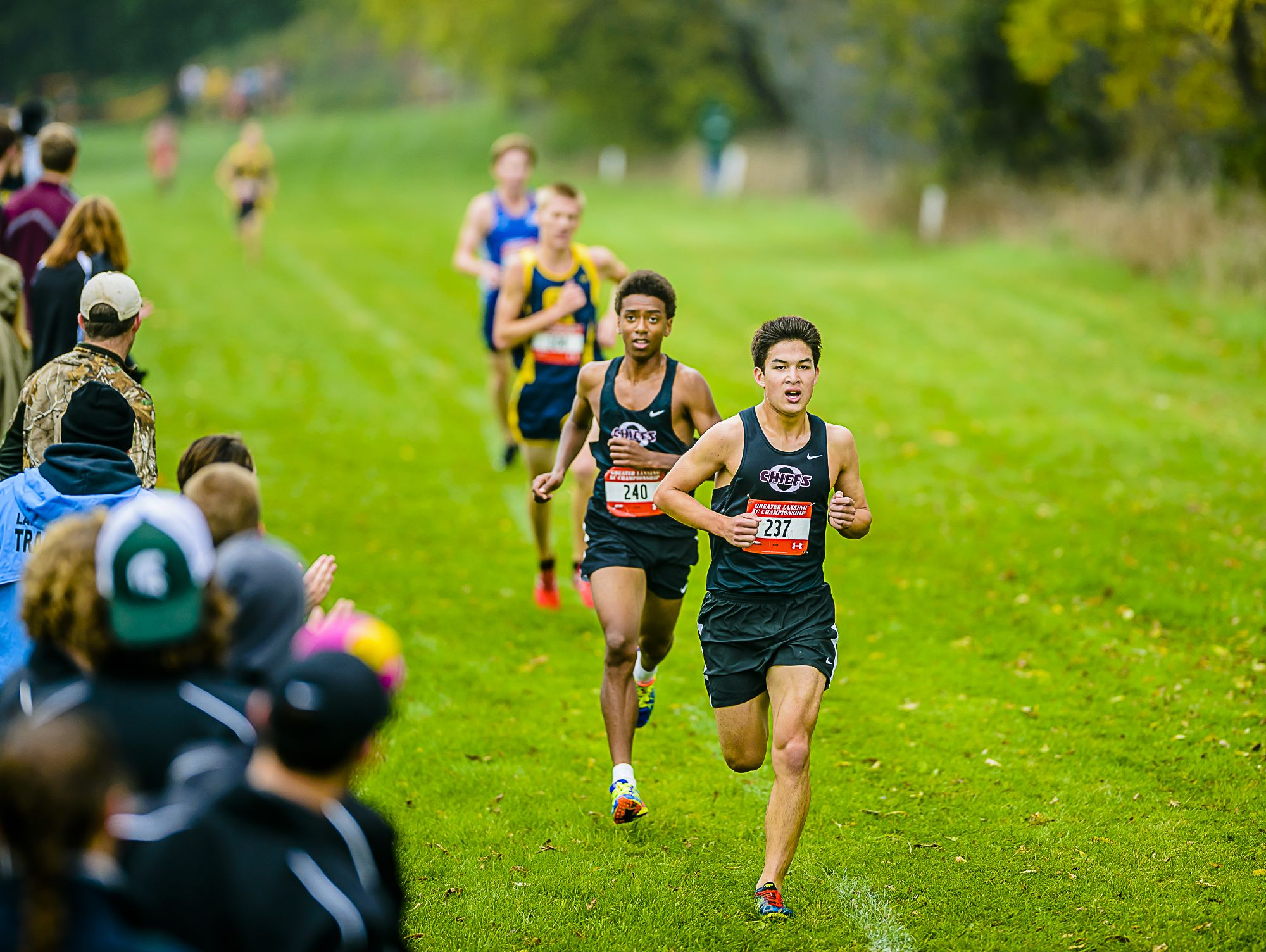 Okemos' Paul McKinley, 237, turns on the jets as he nears the finish at the Greater Lansing Cross Country Championships earlier this month.