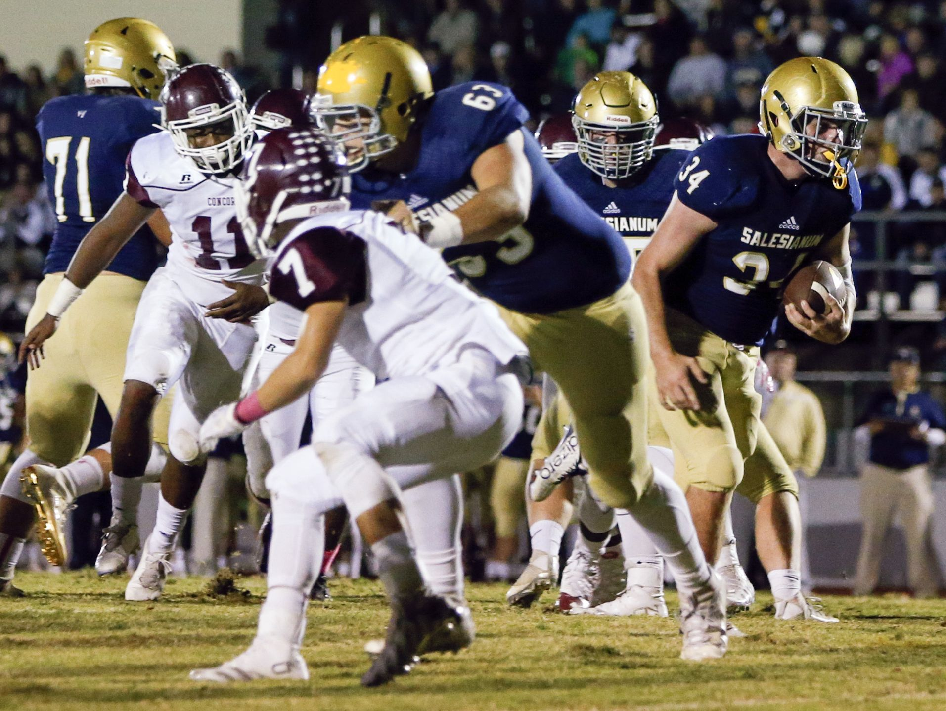 Salesianum's Peyton Mullin gets through his line, including blocker Domenico Marra (63) for a touchdown against Concord to open the scoring in the first quarter at Baynard Stadium Saturday.