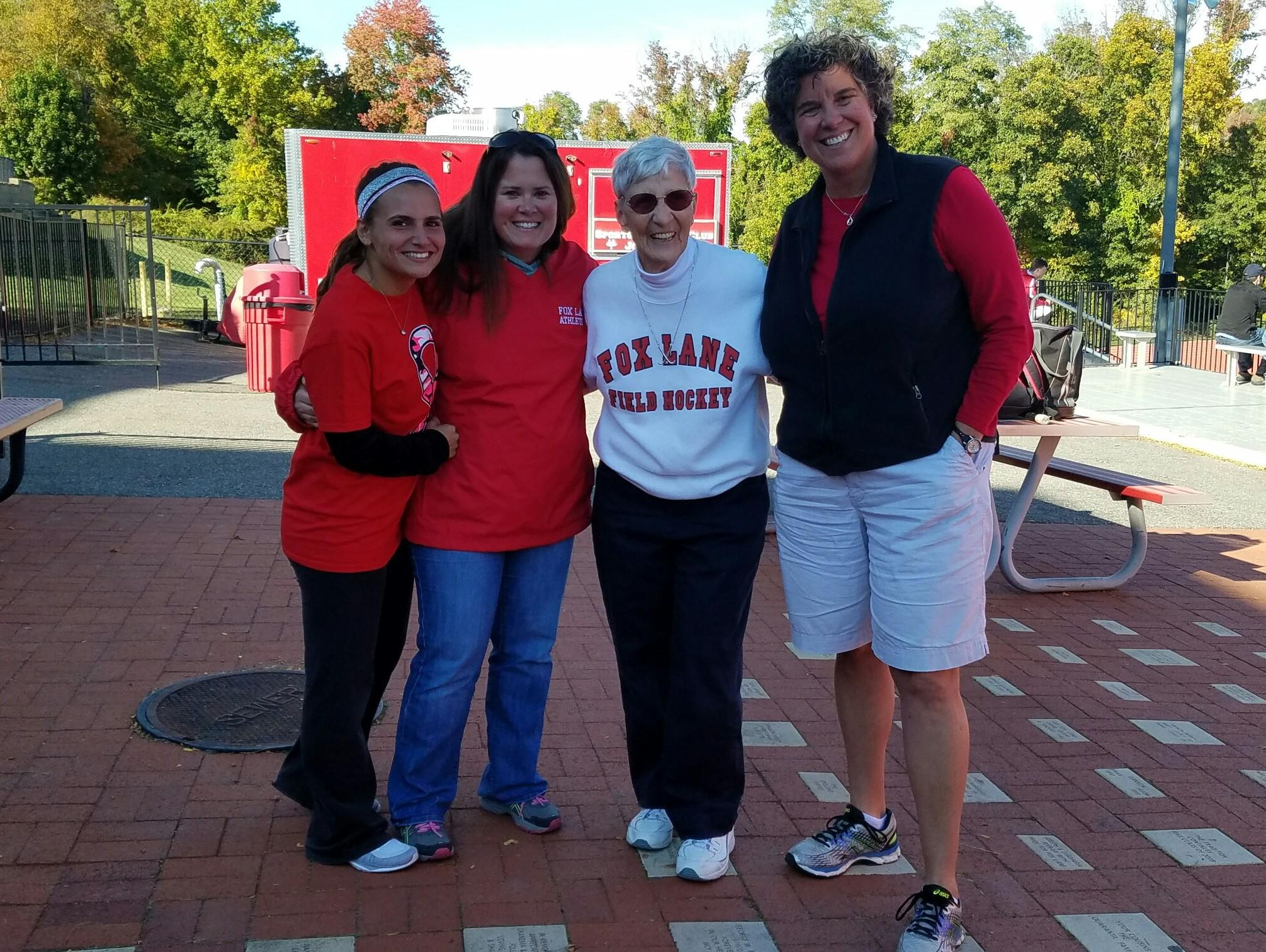 Current Fox Lane coach Kim Gigante and former coaches Heather Miller, Joanne St. George and Beth Staropoli, Fox Lane's current athletic director.
