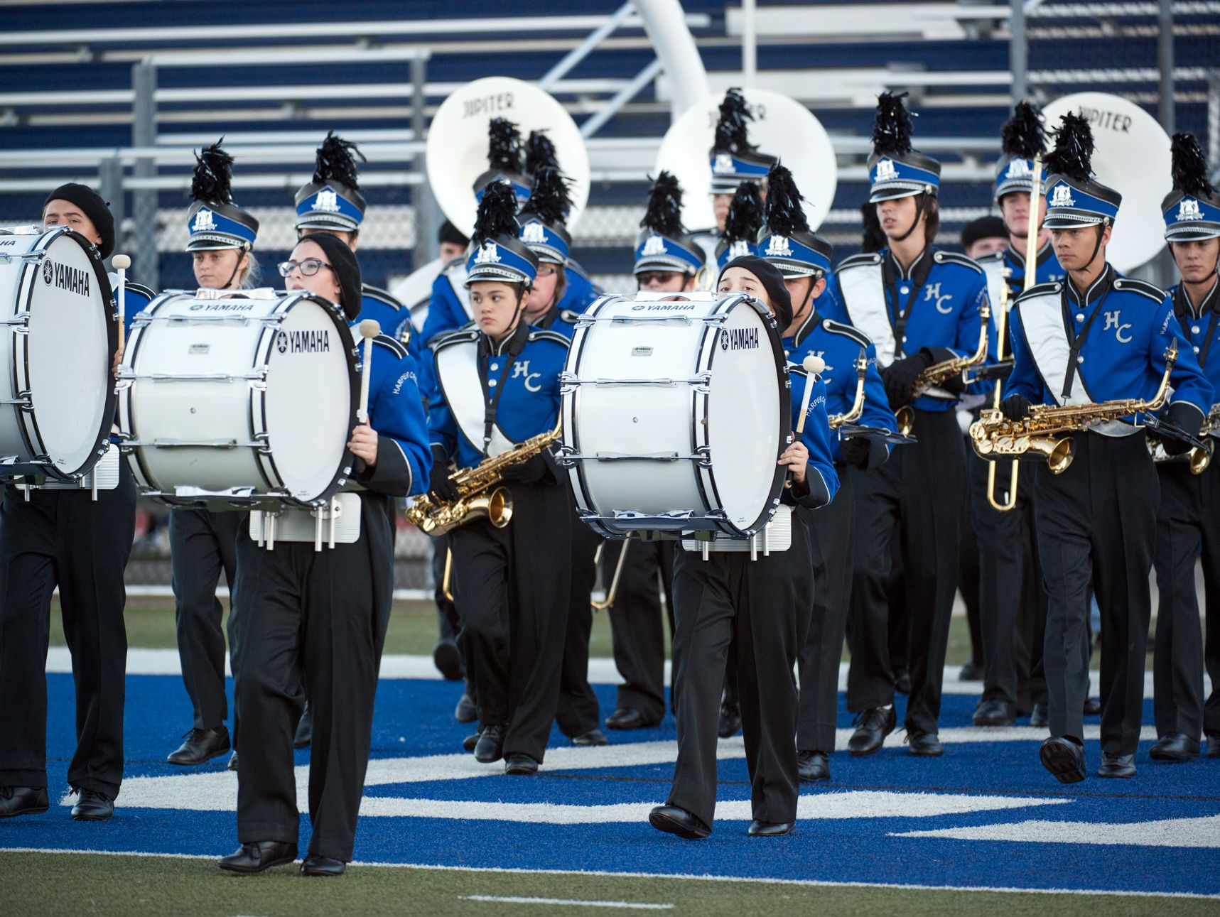 The Harper Creek band takes the field before a game earlier this season.