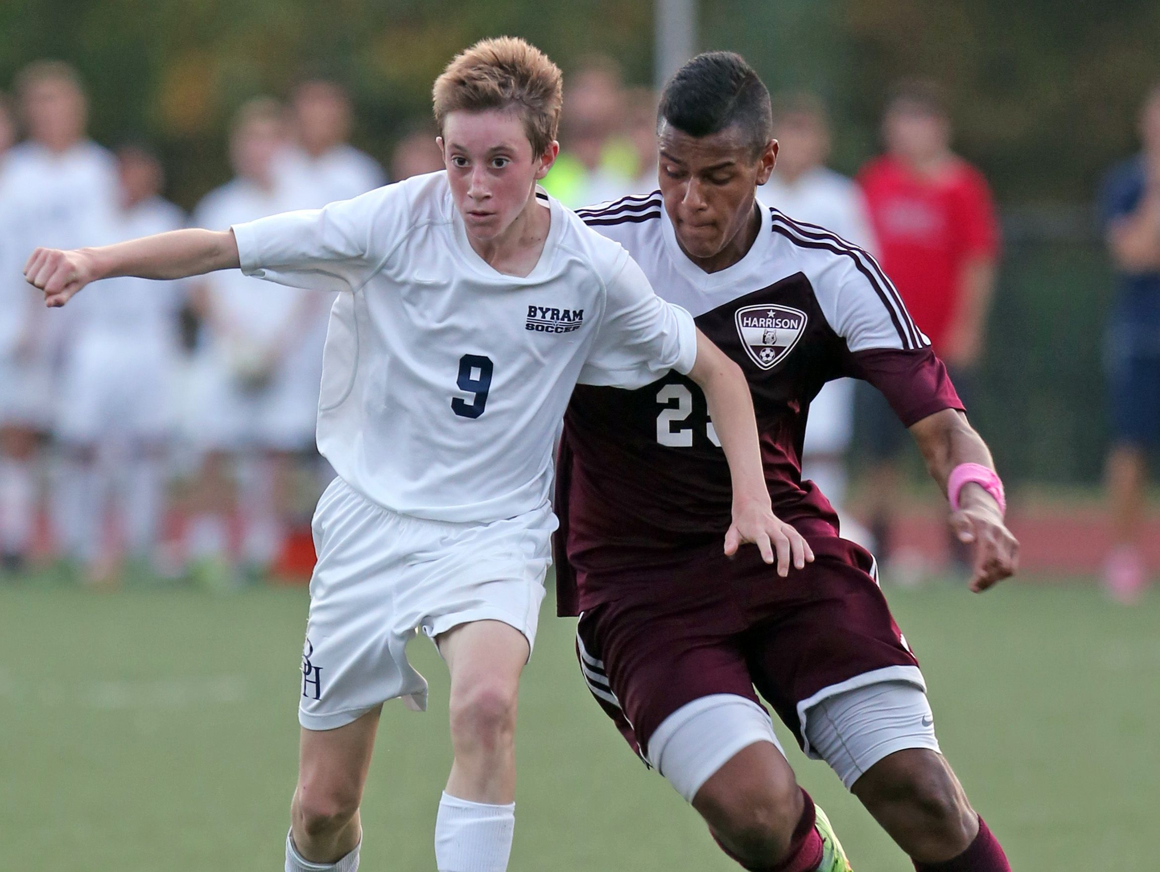 Ryan Noel (9) of Byram Hills and Harrison's Gabe Ferrierra (25) battle for control of the ball during boys soccer game at Byram Hills High School in Armonk Oct. 17, 2016. Byram Hills defeats Harrison 3-1.