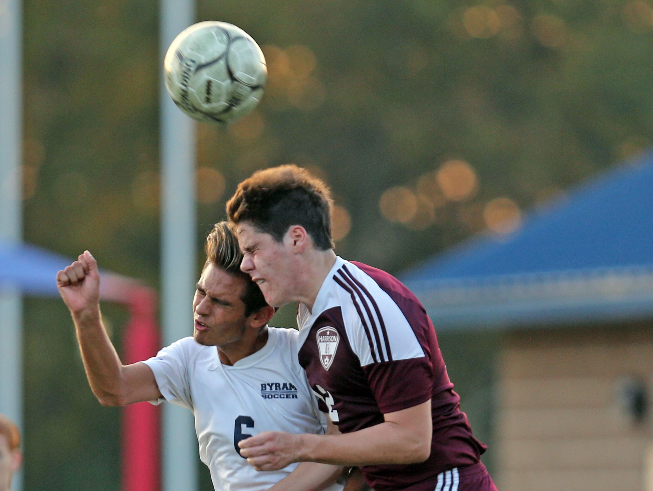 Indra Neil Dan (6) of Byram Hills and Harrison's Sam Glaser (22) battle for control of the ball during boys soccer game at Byram Hills High School in Armonk Oct. 17, 2016. Byram Hills defeats Harrison 3-1.
