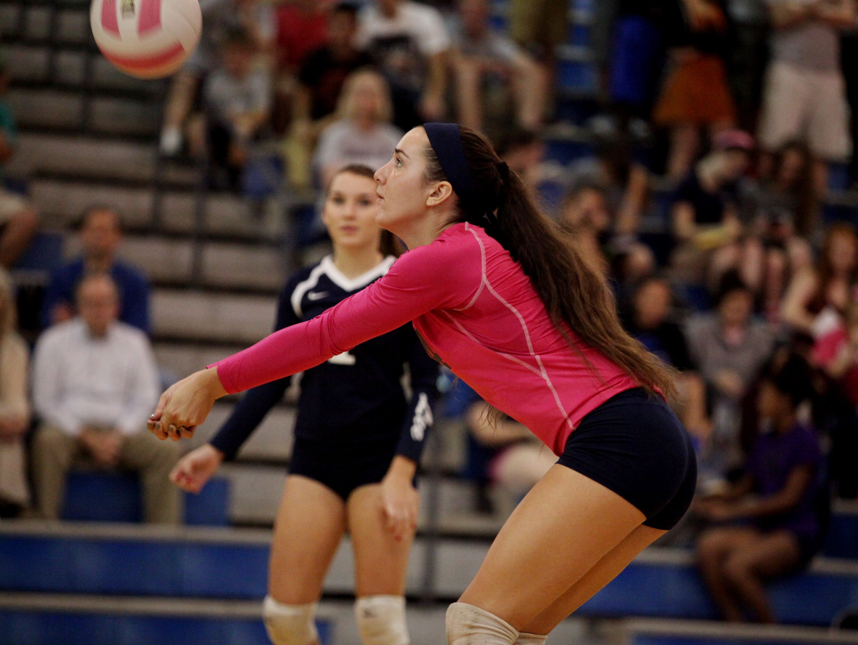 R.E. Lee's MacKensie Bowles bumps the ball during the volleyball match on Tuesday, Oct. 18, 2016 at Fort Defiance.