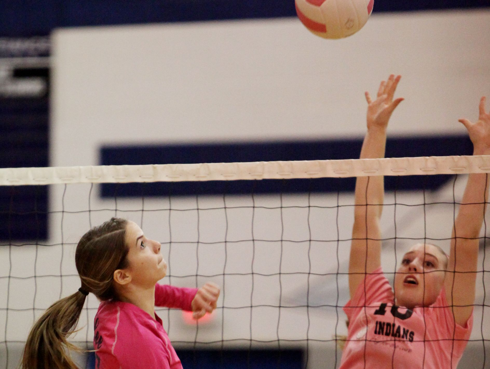 Fort Defiance's Catherine Cramer, right, jumps to block a hit by R.E. Lee's Jennifer Williams during the volleyball match on Tuesday, Oct. 18, 2016 at Fort Defiance.