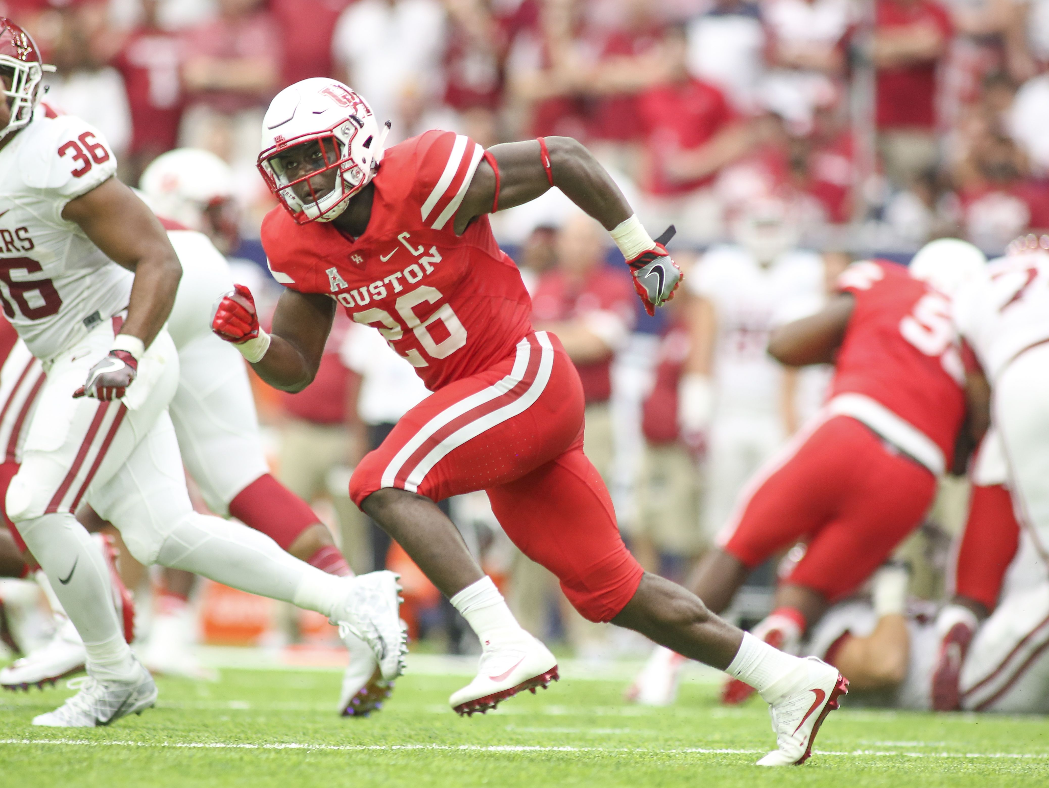 Former Calvary running back Brandon Wilson looks to make a play on the ball as a defensive back for Houston in its win over Oklahoma earlier this season.