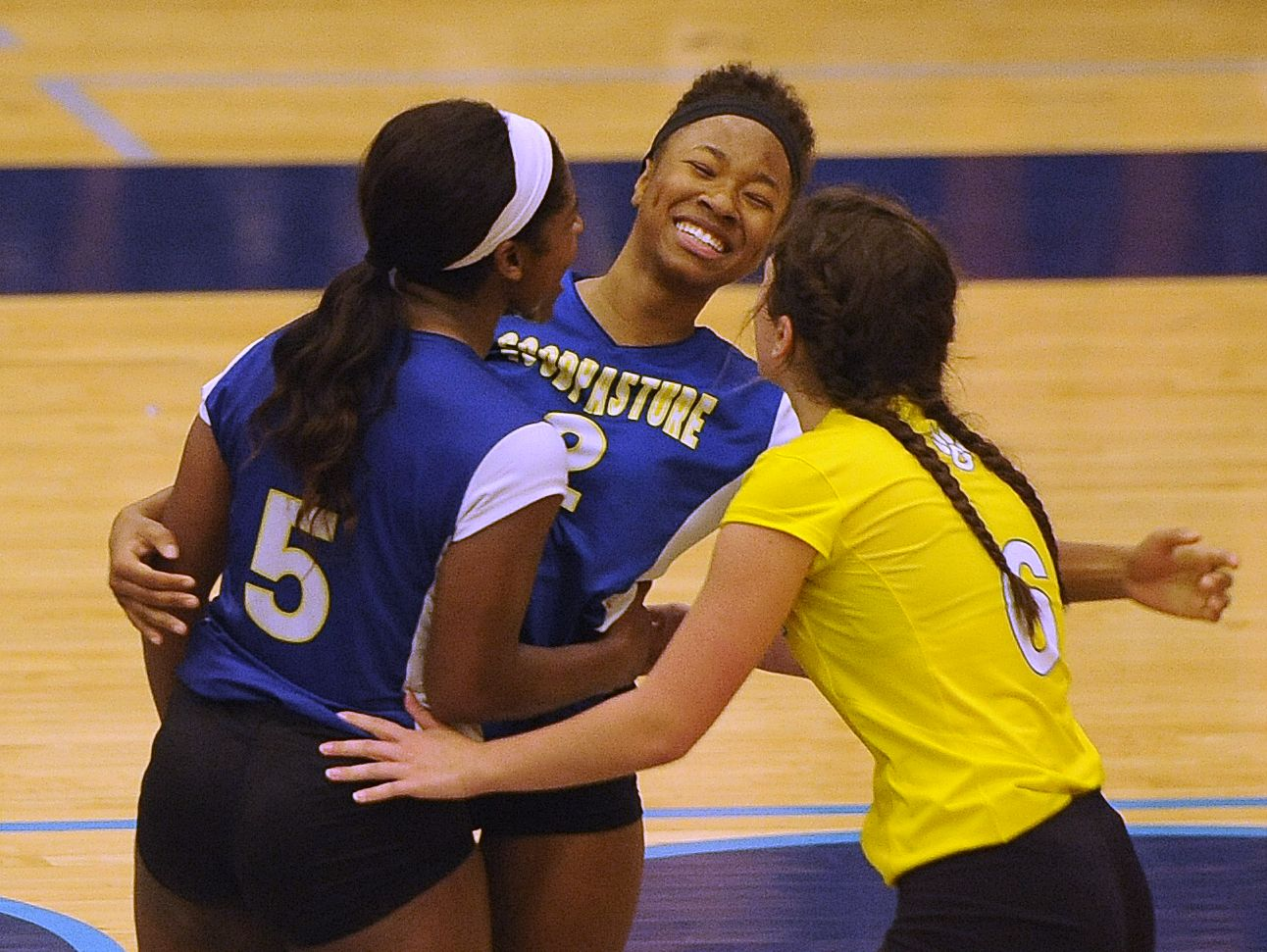 Goodpasture's Jayleigh Rogan (5), Victoria Johnson (2) and Caroline Steele (6) celebrate a point during the Lady Cougars' 3-1 win over Summertown in the Class A state volleyball tournament on Wednesday.