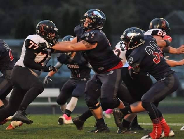 Lakewood lineman Dane Stambaugh, center, is headed to the East-West All-American Bowl in December.