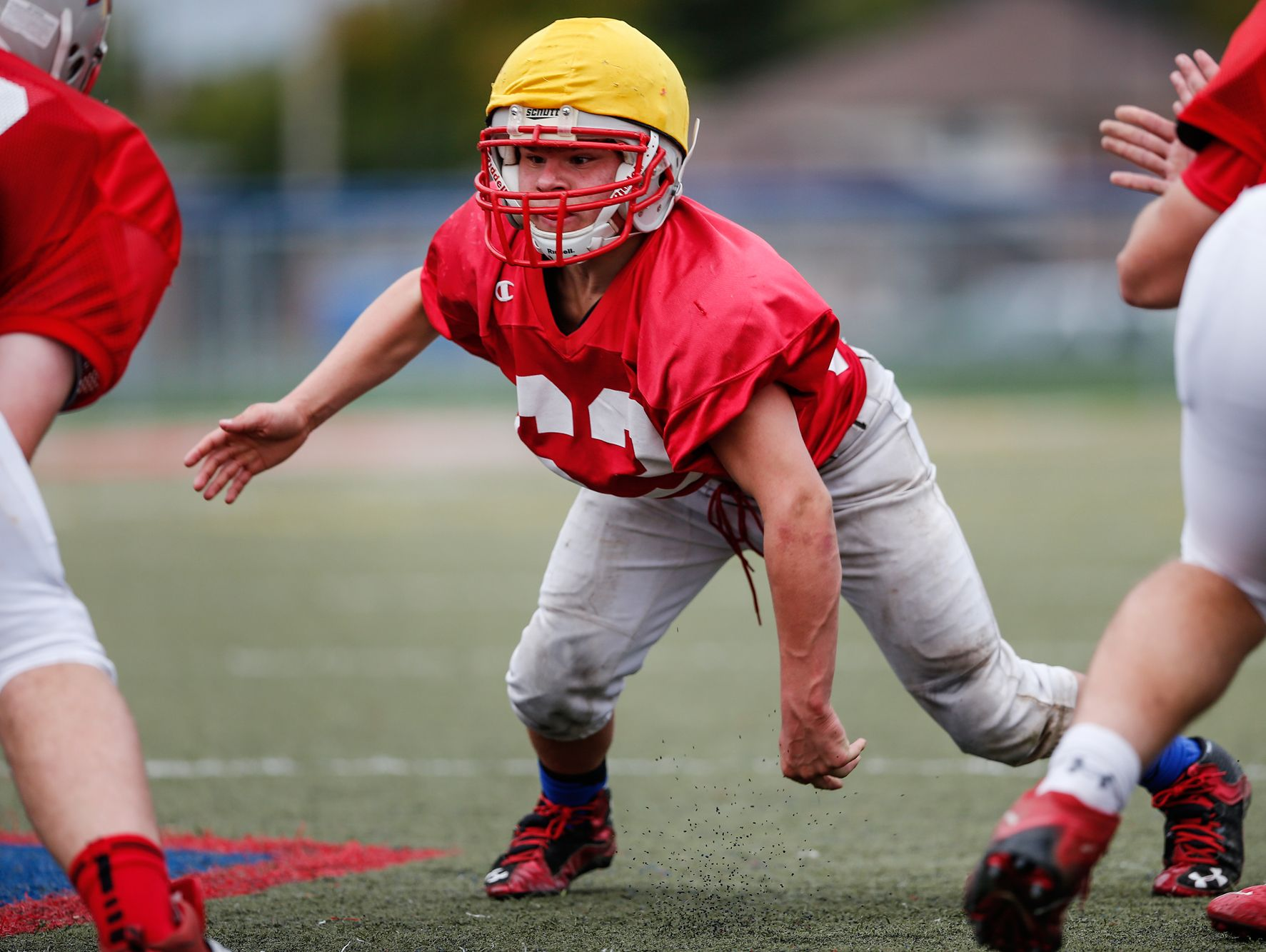 From left, Roncalli Rebels nose tackle Max Quebe, a 5-foot-2-inch, 135-pound Russian adoptee, gets out of his stance and prepares to find the football during practice on Oct. 19, 2016. Roncalli offensive lineman Sean Hornek (79) snaps the ball.
