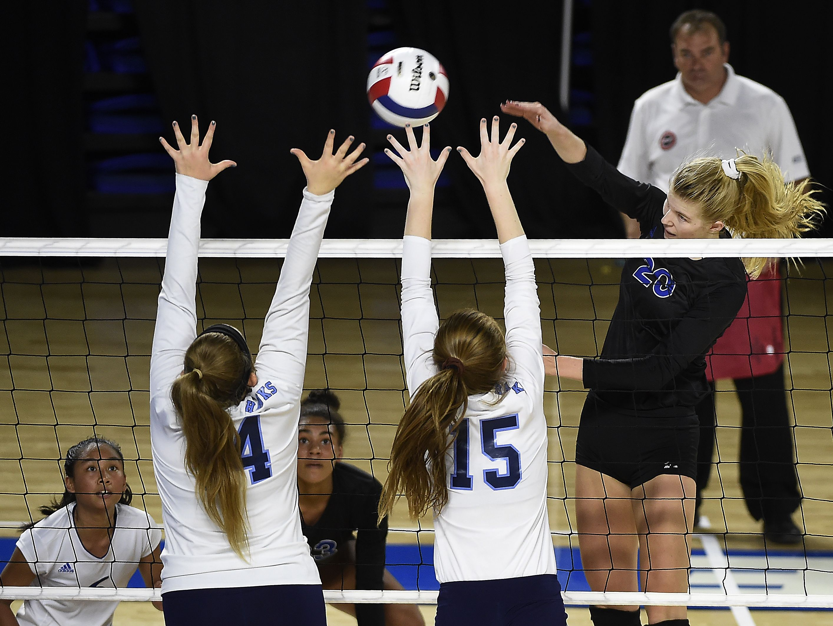 Brentwood's Garrett Joiner (20) spikes the ball as Brentwood plays Hardin Valley at MTSU's Murphy Center during the TSSAA volleyball state tournament. Thursday Oct. 20, 2016, in Murfreesboro, Tenn.