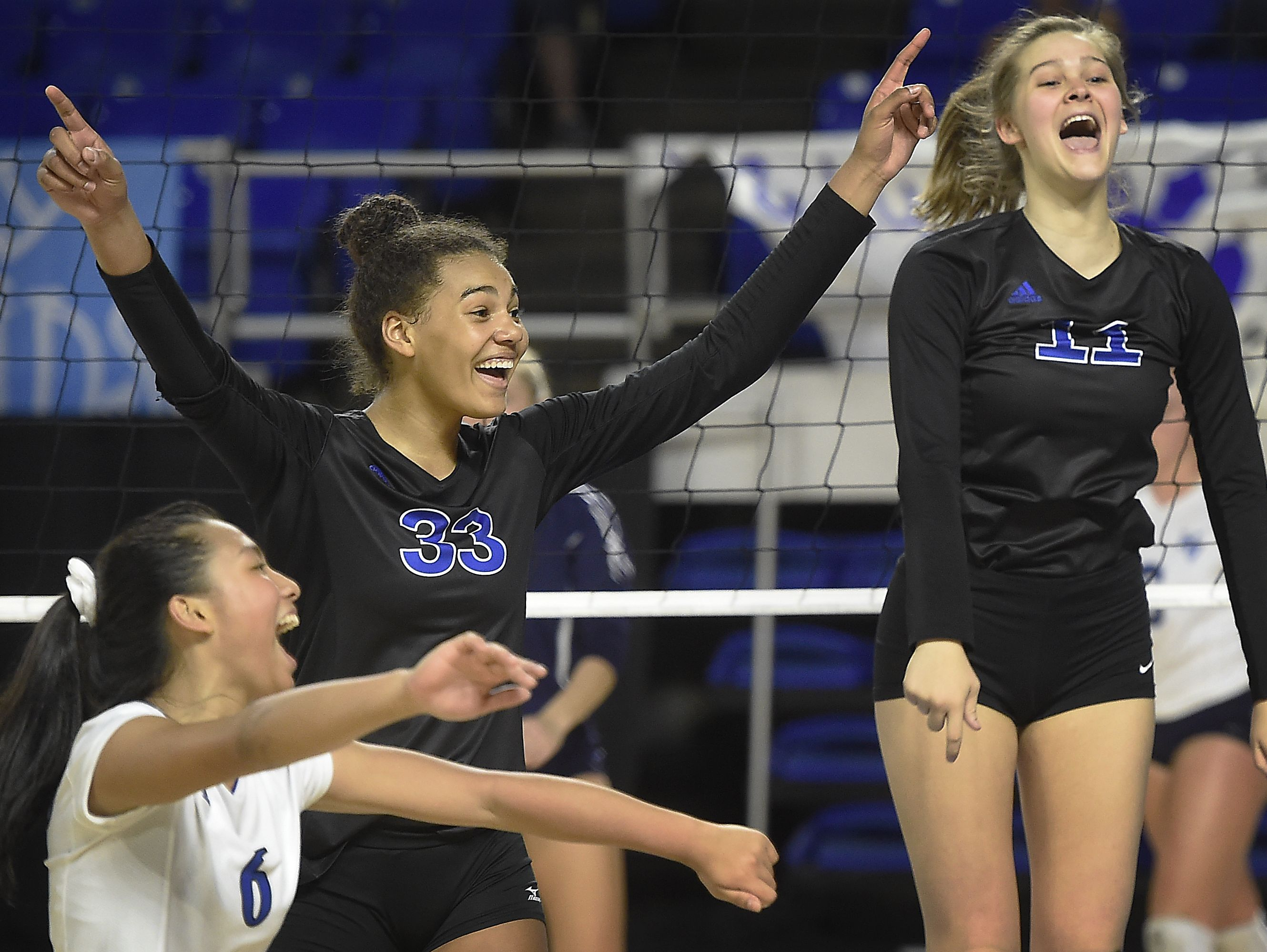 Brentwood players Andrea Acevedo (6), Logan Eggleston (33) and Celia Lamb (11) celebrate their win over Hardin Valley at MTSU's Murphy Center during the TSSAA volleyball state tournament. Thursday Oct. 20, 2016, in Murfreesboro, Tenn.