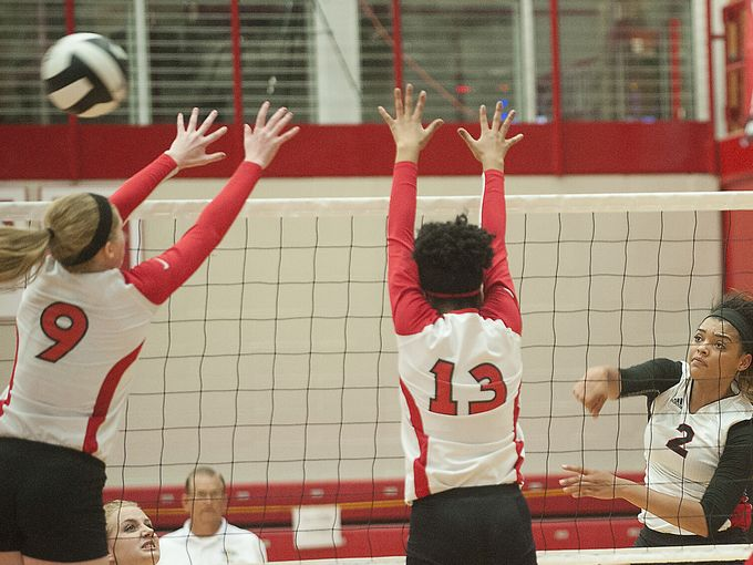 New Albany's Allyson Cathey attempts a kills against Jeffersonville in the teams' sectional opener.
