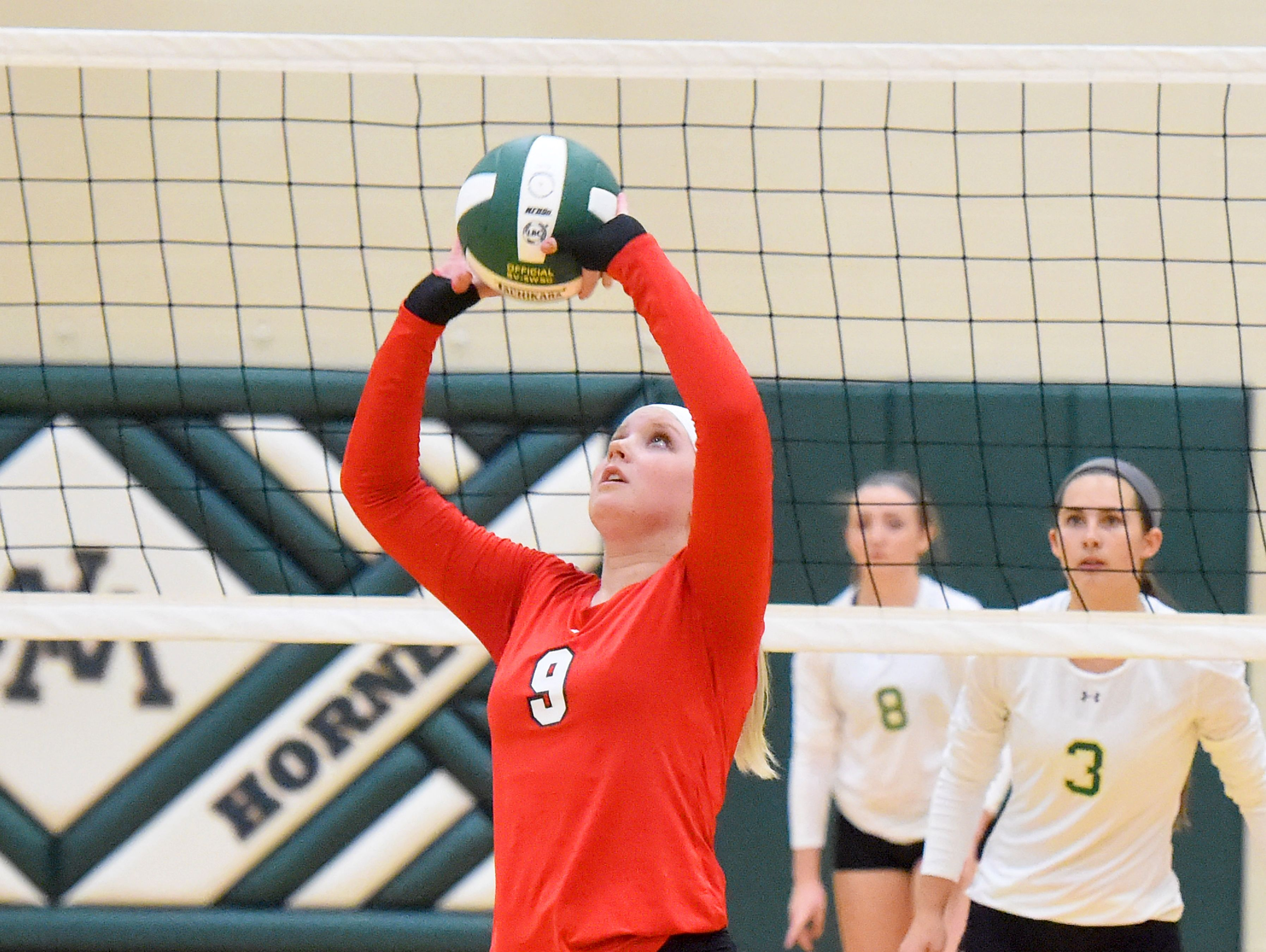 Riverheads' Macey Snyder sets the ball during a volleyball match played in Fishersville on Thursday, Oct. 20, 2016.