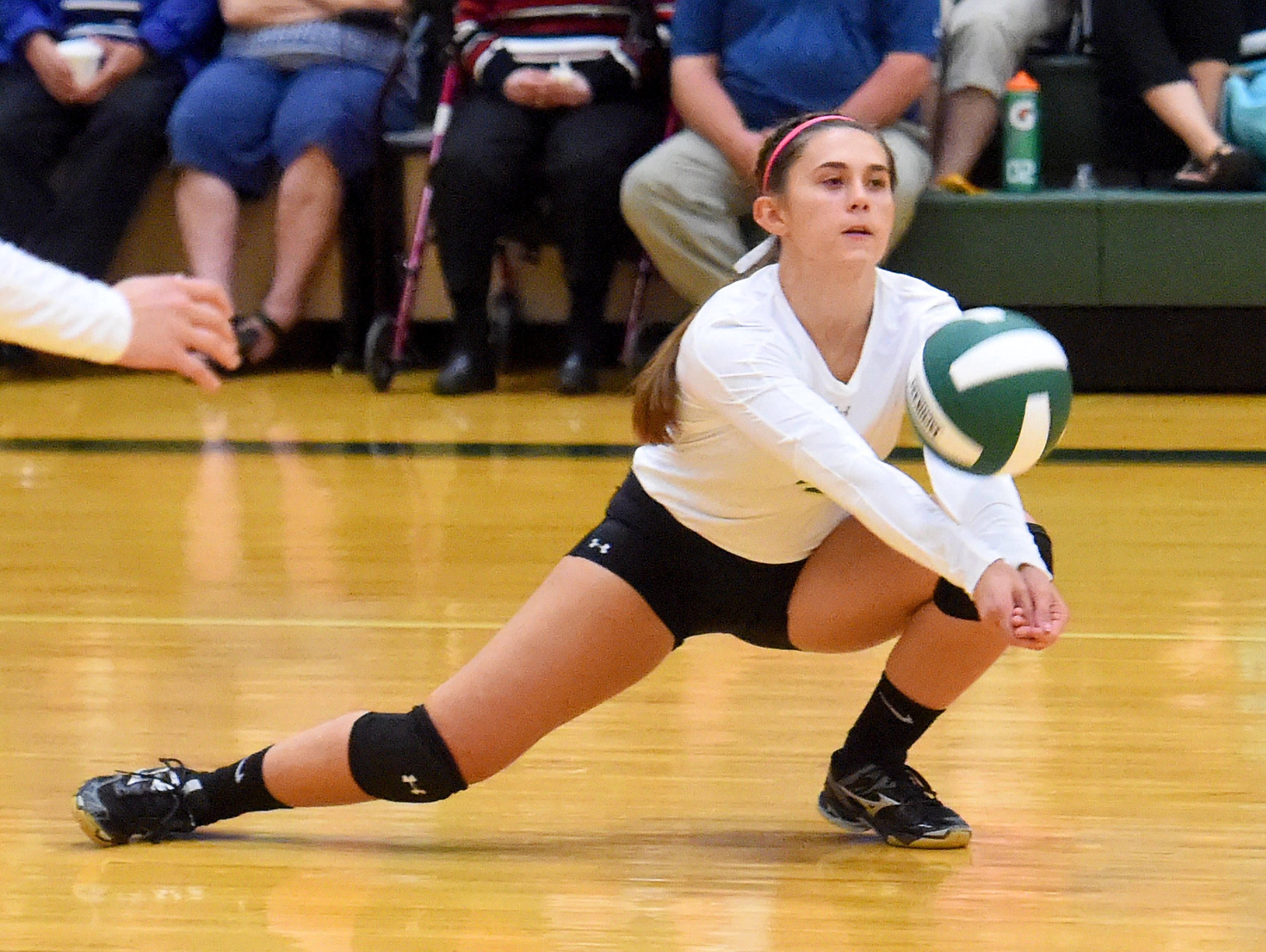 Wilson Memorial's Sam Kershner goes low to bump the ball during a volleyball match played in Fishersville on Thursday, Oct. 20, 2016.