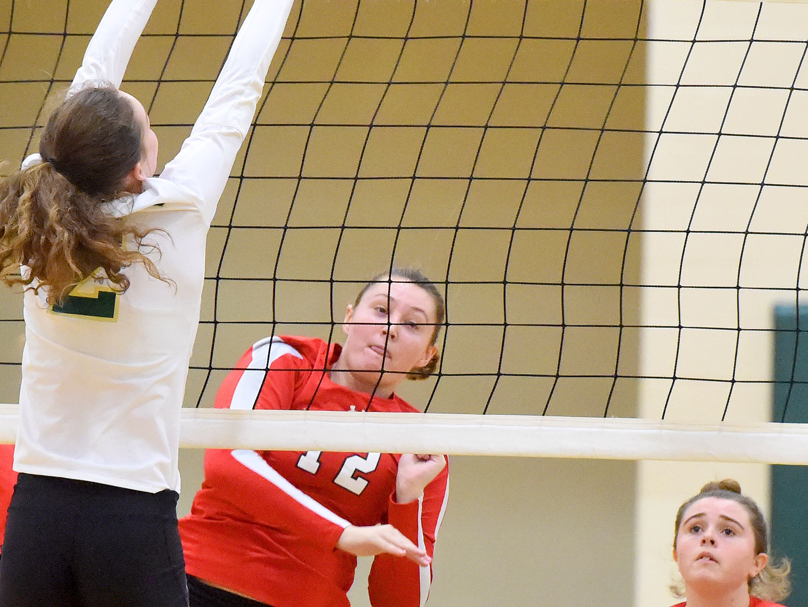 Riverheads' Emma Casto spikes the ball during a volleyball match played in Fishersville on Thursday, Oct. 20, 2016.