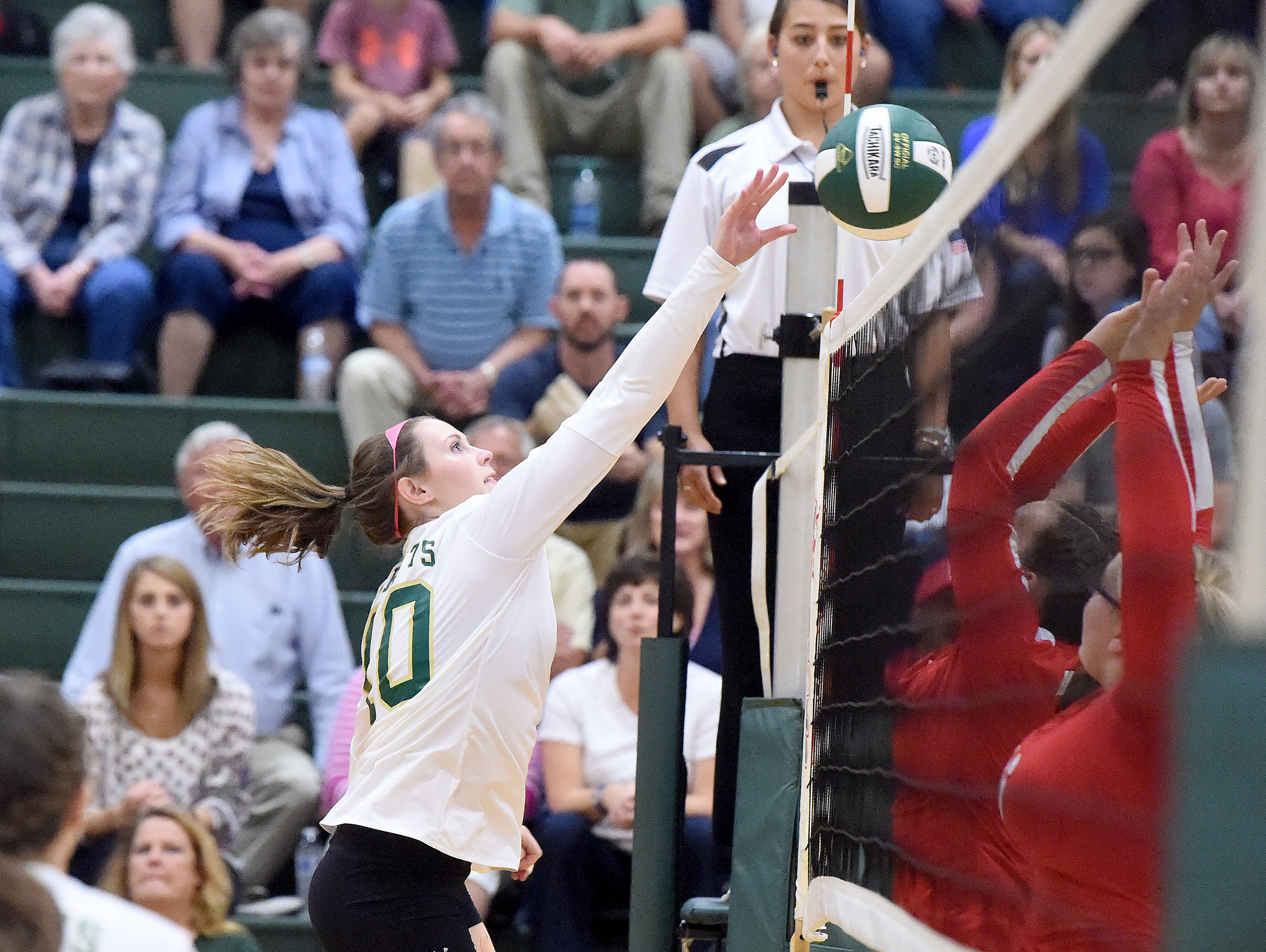 Wilson Memorial's Addison Tuttle sends the ball back across the net during a volleyball match played in Fishersville on Thursday, Oct. 20, 2016.