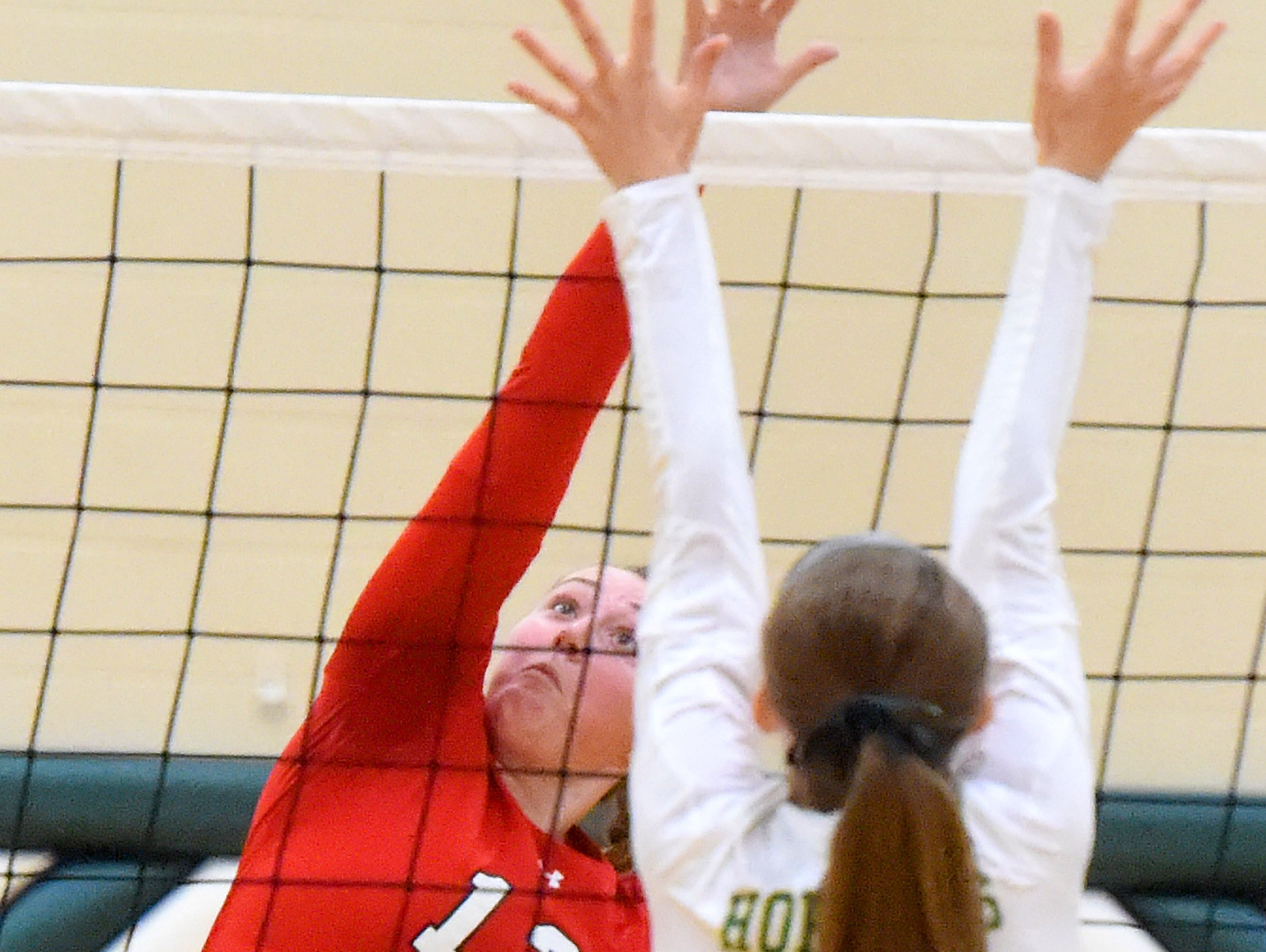 Riverheads' Emma Casto hits the ball back across the net from Emma Harrison during a volleyball match played in Fishersville on Thursday, Oct. 20, 2016.