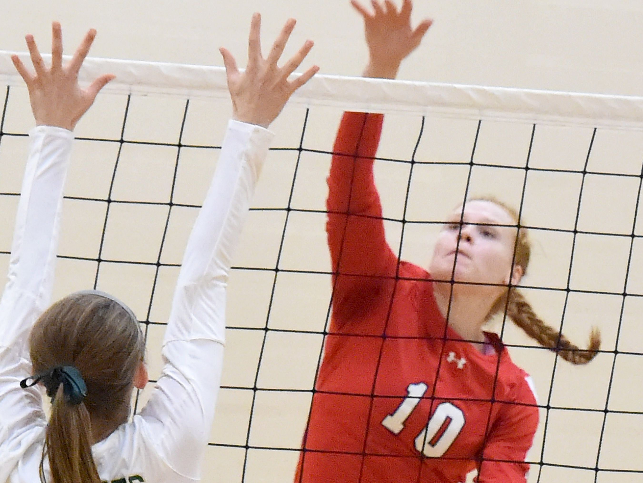 Riverheads' Blake Bartley spikes the ball across the net as Wilson Memorial's Emma Harrison tries to block during a volleyball match played in Fishersville on Thursday, Oct. 20, 2016.