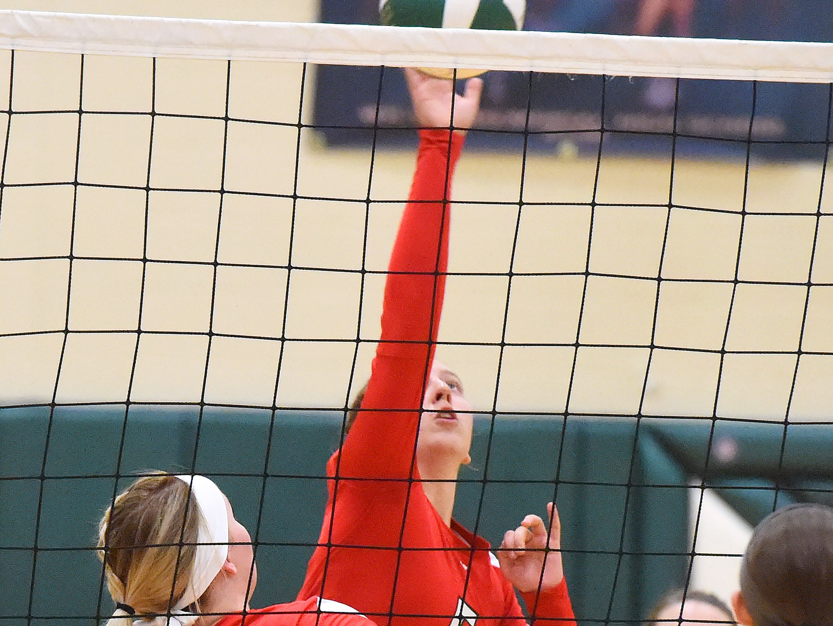 Riverheads' Jenni Miller spikes the ball during a volleyball match played in Fishersville on Thursday, Oct. 20, 2016.