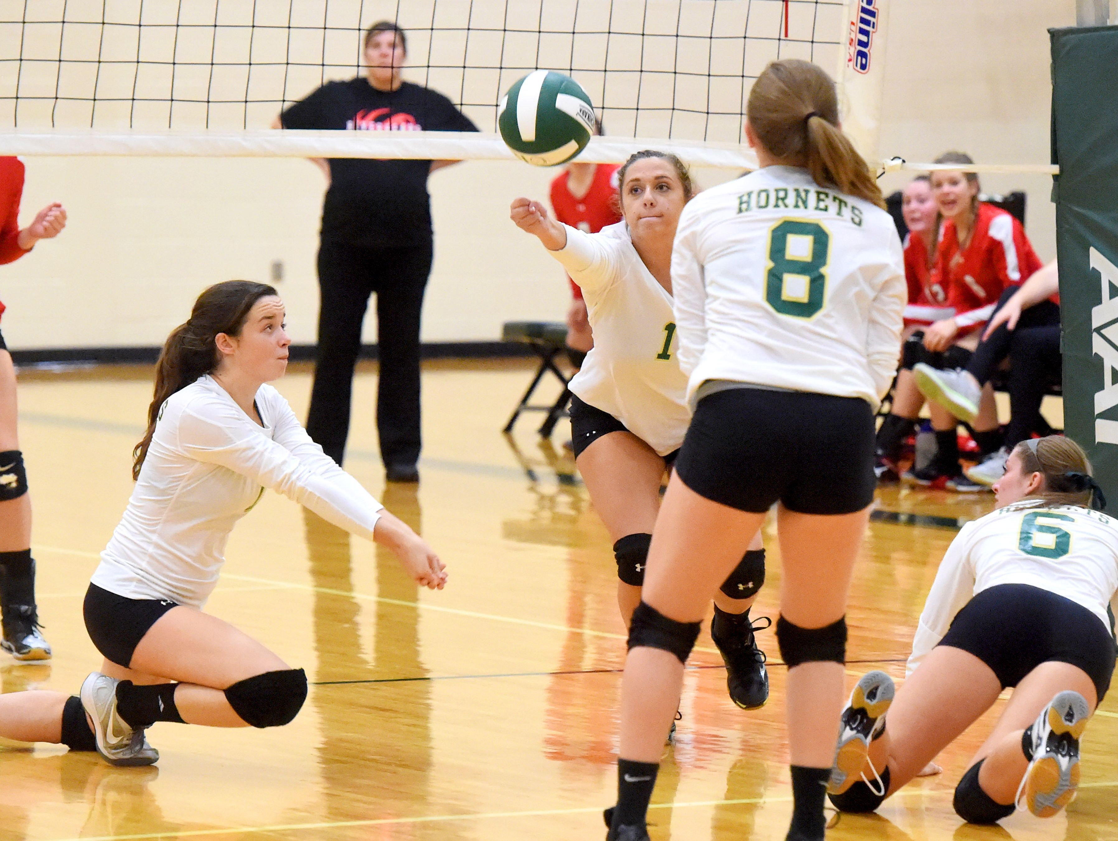 Wilson Memorial's Madison Crist gets to the ball to keep it in play so her team can go on to score and win the first game with teammate Emma Nargi, Grace Carter and Emma Harrison back her up during a volleyball match played in Fishersville on Thursday, Oct. 20, 2016.