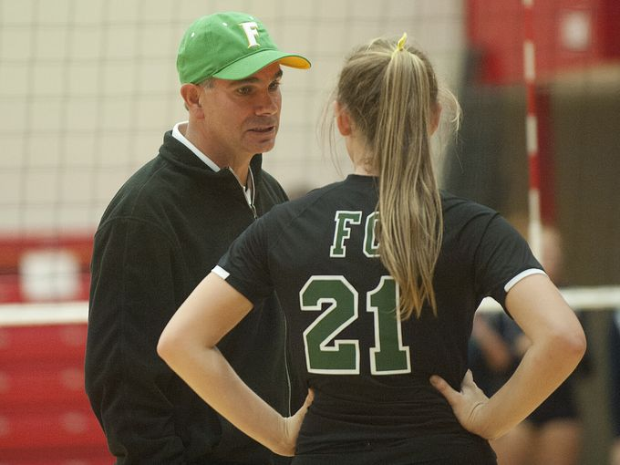 Floyd Central coach Bart Powell instructs Taylor Hodges in the Highlanders' first-round matchup Thursday.