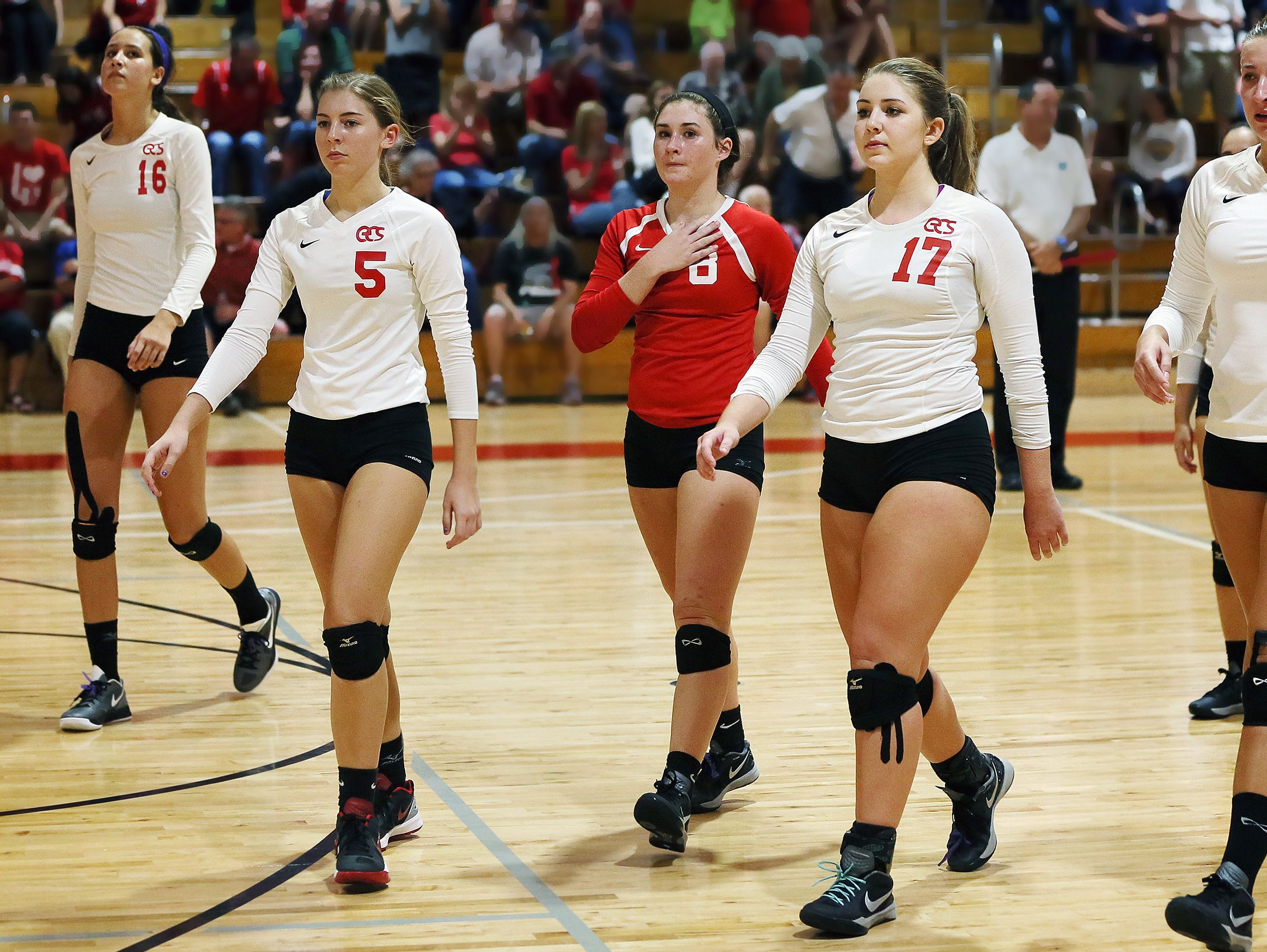 Evangelical Christian School players leave the court after losing 3-0 to Seacrest Country Day School on Thursday in the district 3A-6 volleyball final at ECS in south Fort Myers.