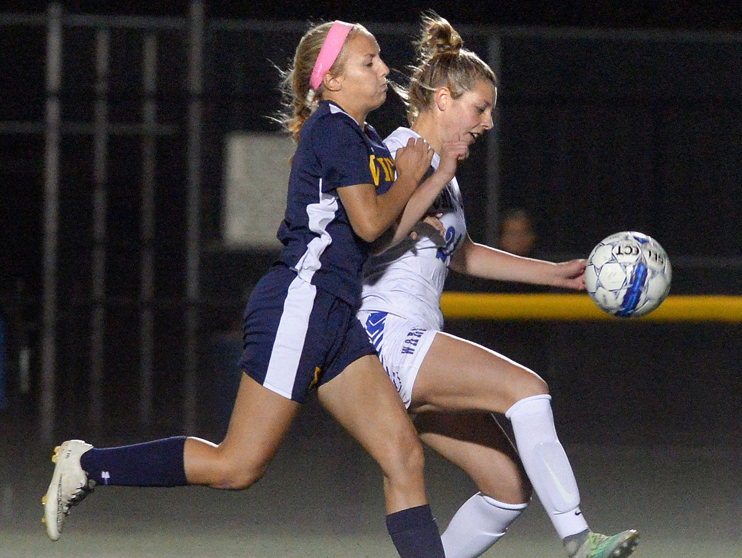Webster Schroeder's Maddy Lowe, right, shields the ball from Victor's Serena Uhl during a regular season game at Schroeder earlier this month.