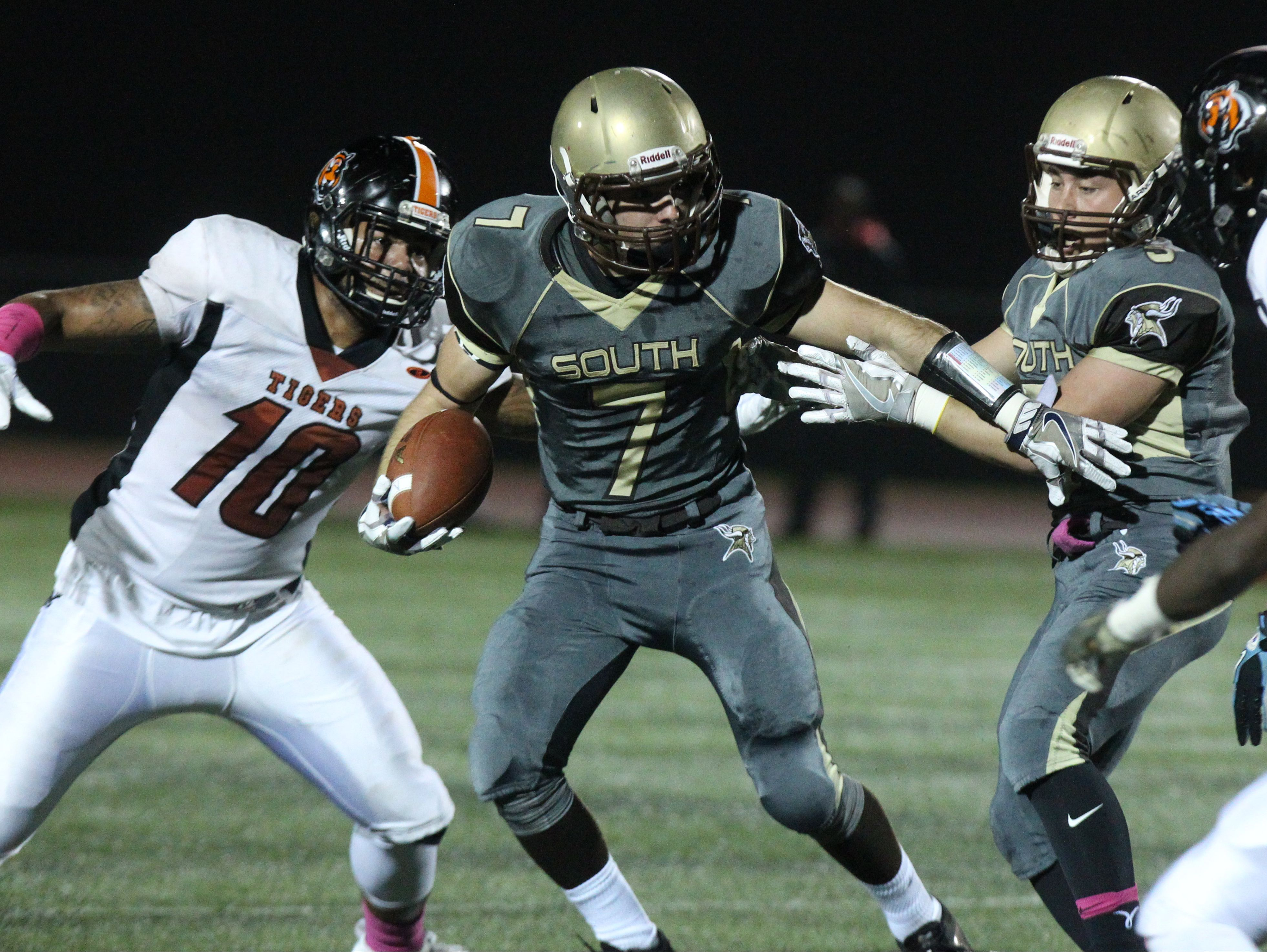 Clarkstown South's Sam Mistretta gets past Spring Valley's Devan Lawson during their Class AAquarterfinal at Clarkstown South Friday night.