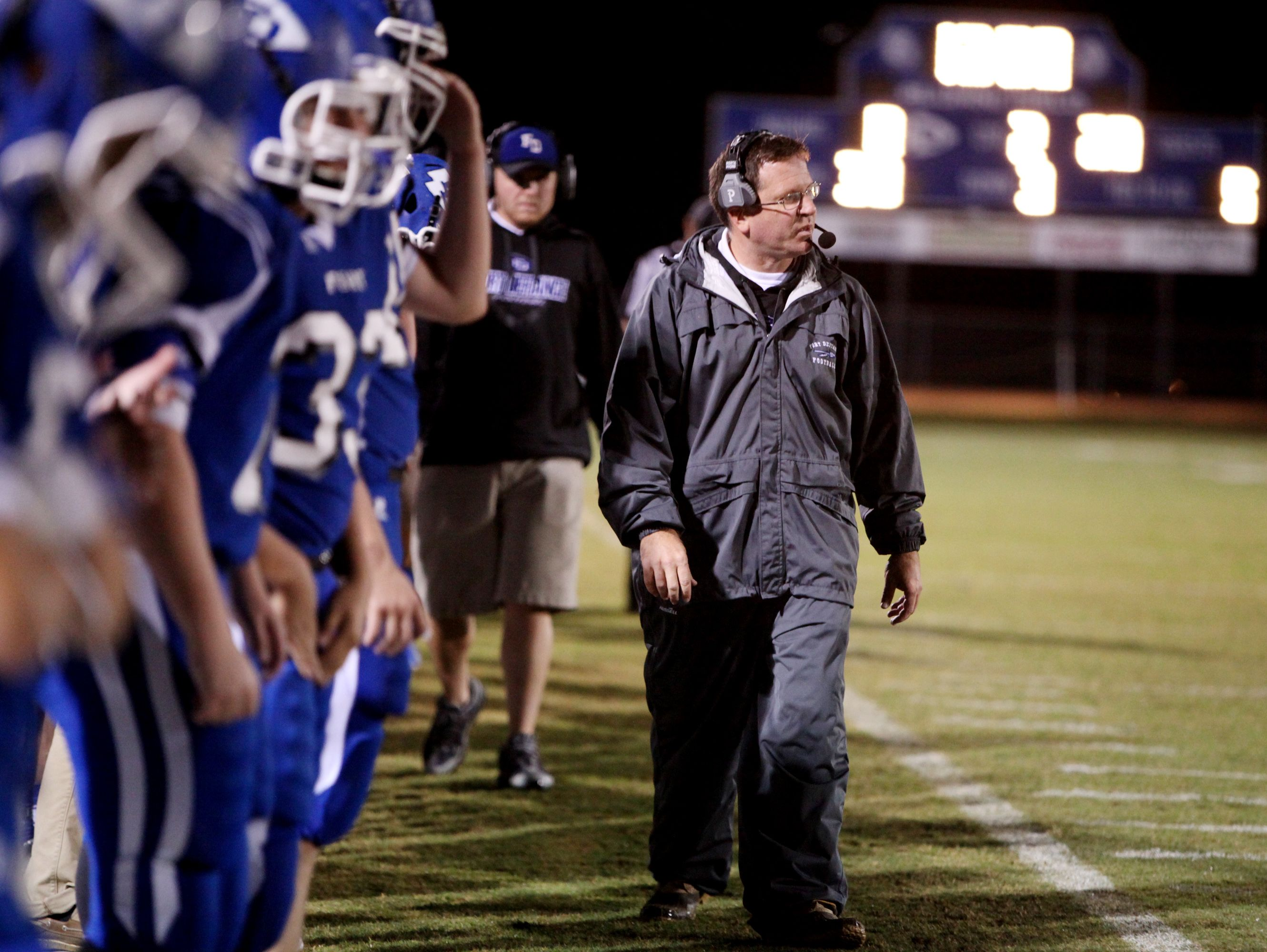 Fort Defiance head coach Dan Rolfe moves down field during the second quarter of the game against Harrisonburg on Friday, Oct. 21, 2016 at Fort Defiance.