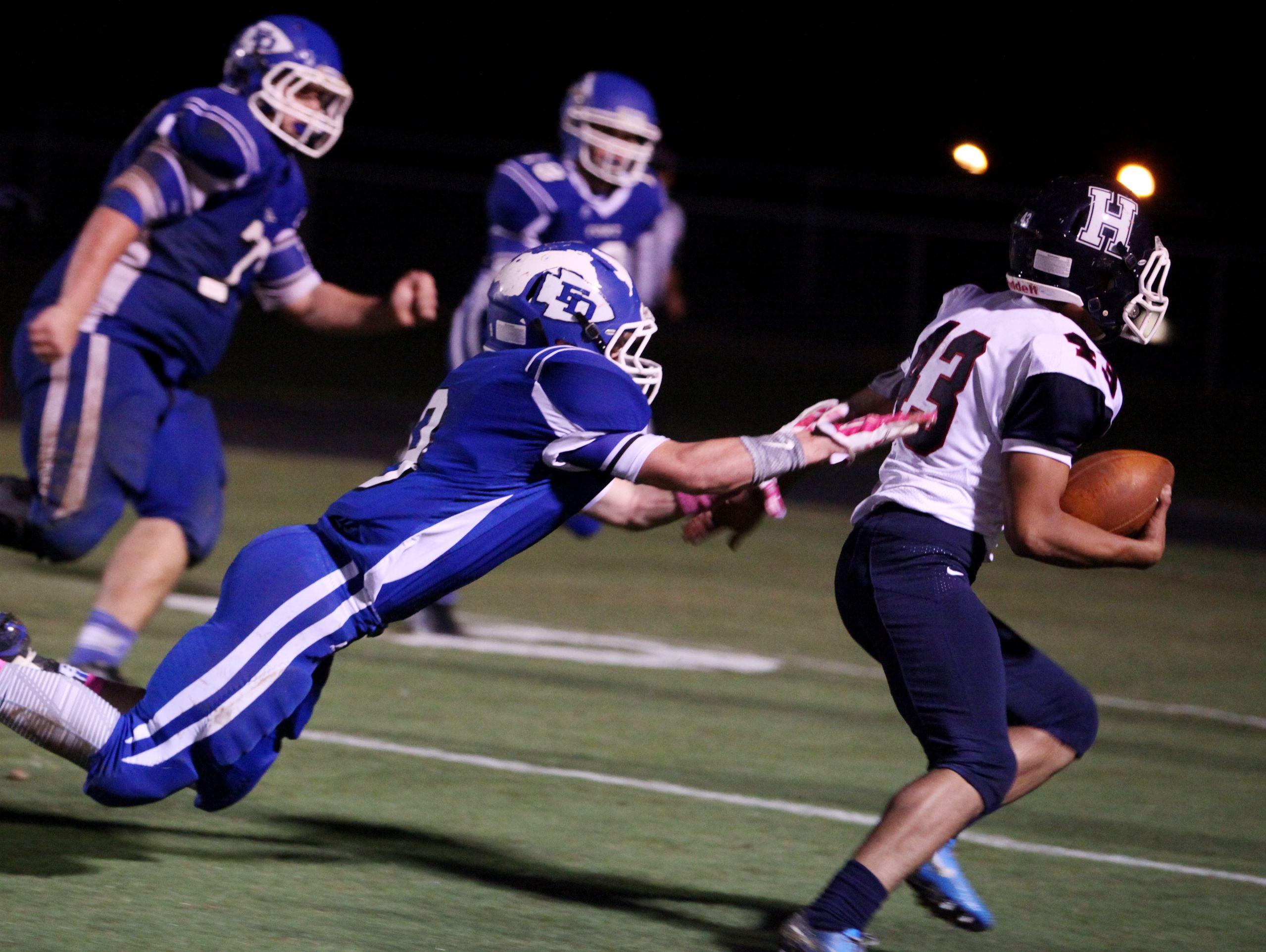 Fort Defiance's Matthew Wonderley dives to tackle Harrisonburg's Roberto Gonzalez-Cavazos as he tries for a two-point conversion during the second quarter of the game on Friday, Oct. 21, 2016 at Fort Defiance.