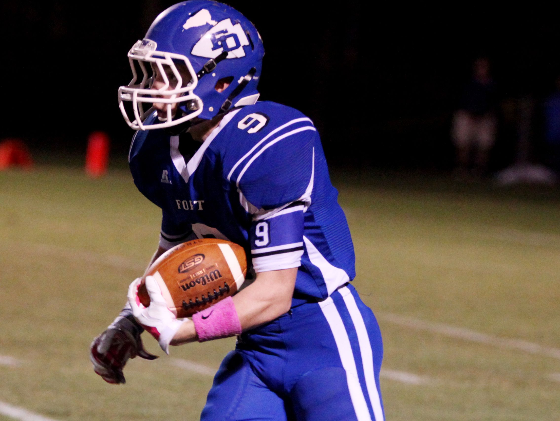 Fort Defiance's Matthew Wonderley catches the kick from Harrisonburg during the second quarter of the game on Friday, Oct. 21, 2016 at Fort Defiance.