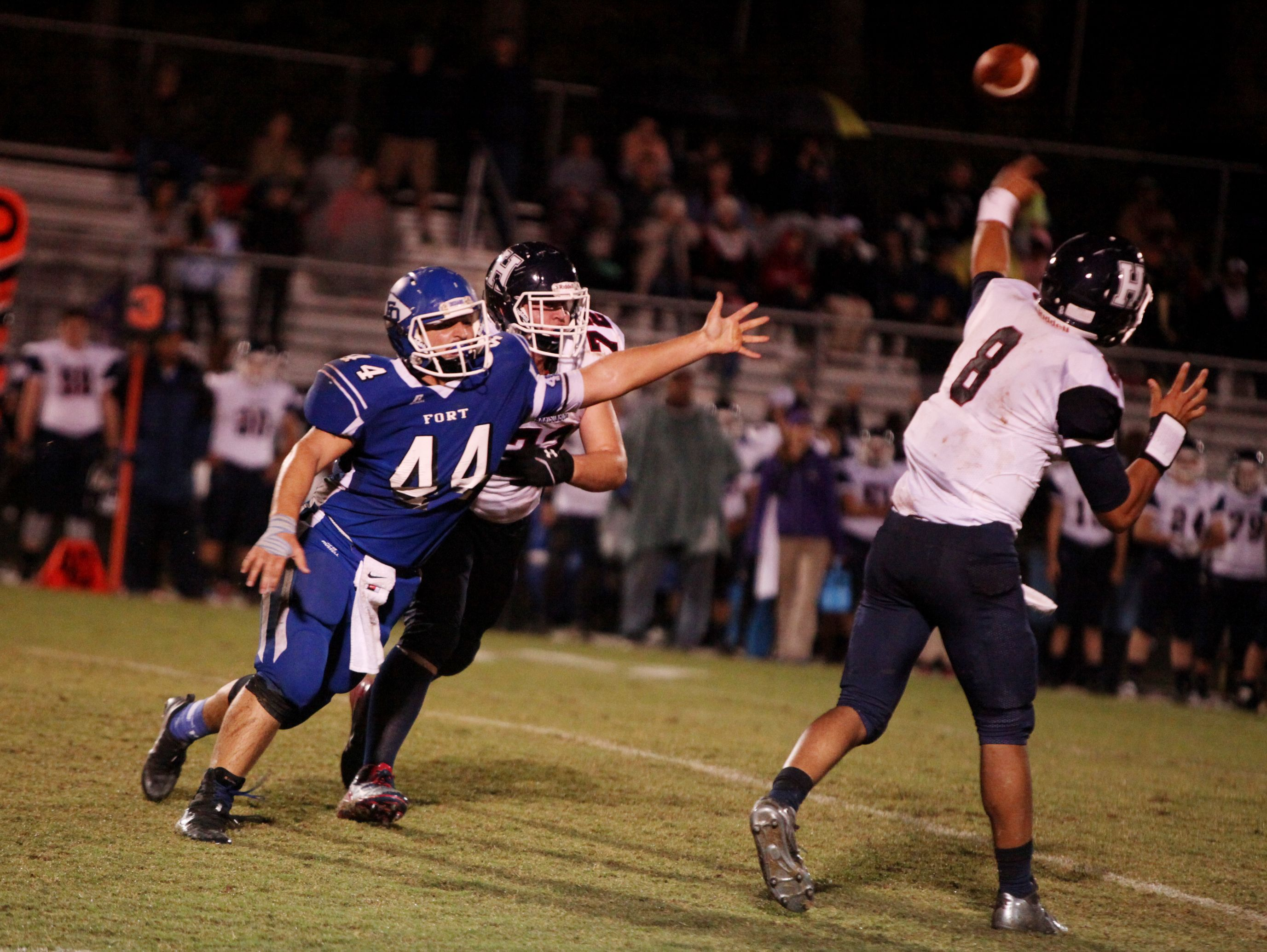 Fort Defiance's Austin Fitzwater tries to block a pass by Harrisonburg's AC White during the second quarter of the game on Friday, Oct. 21, 2016 at Fort Defiance.