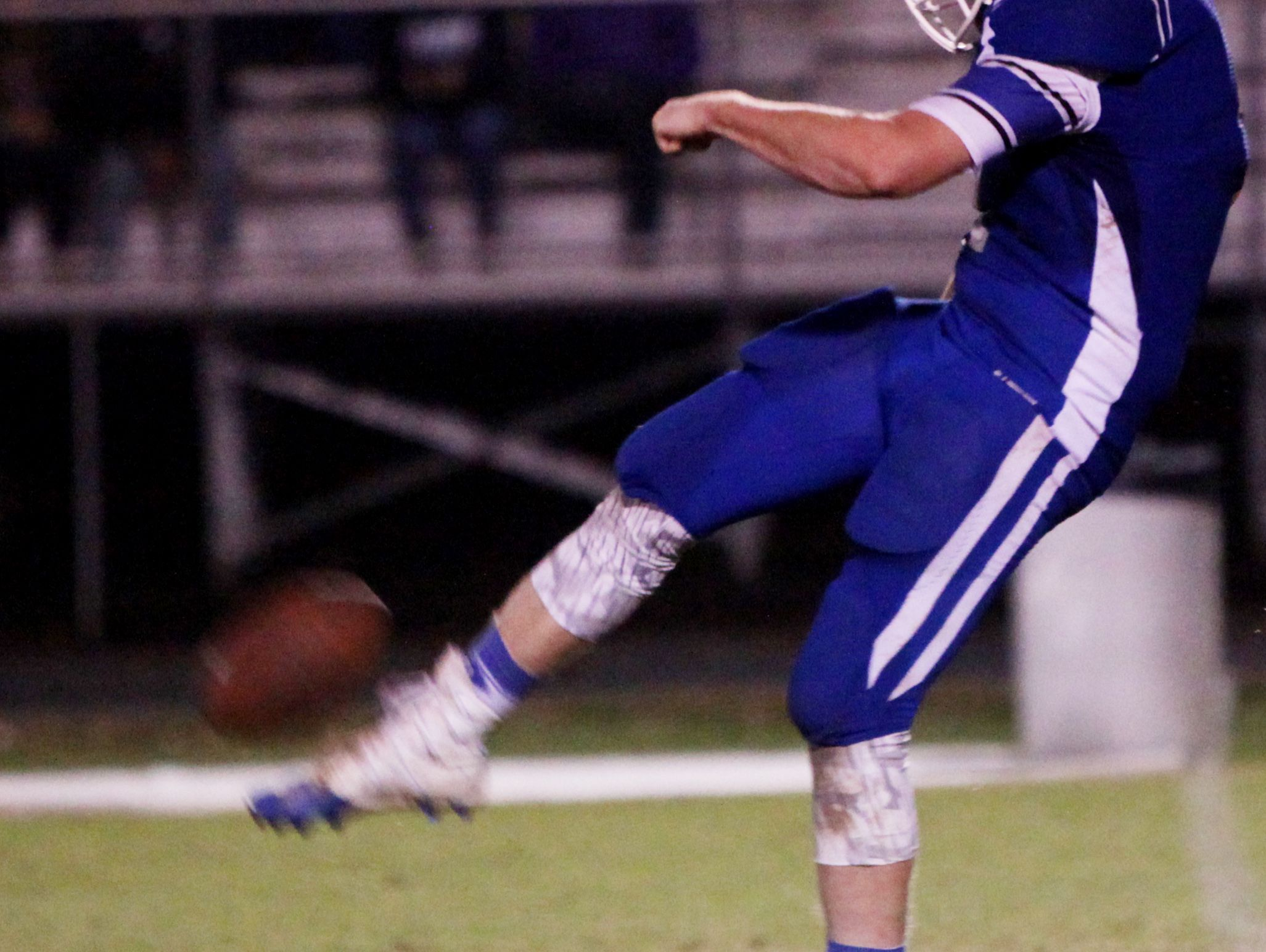 Fort Defiance's Trenton Campbell punts to Harrisonburg during the game on Friday, Oct. 21, 2016 at Fort Defiance.