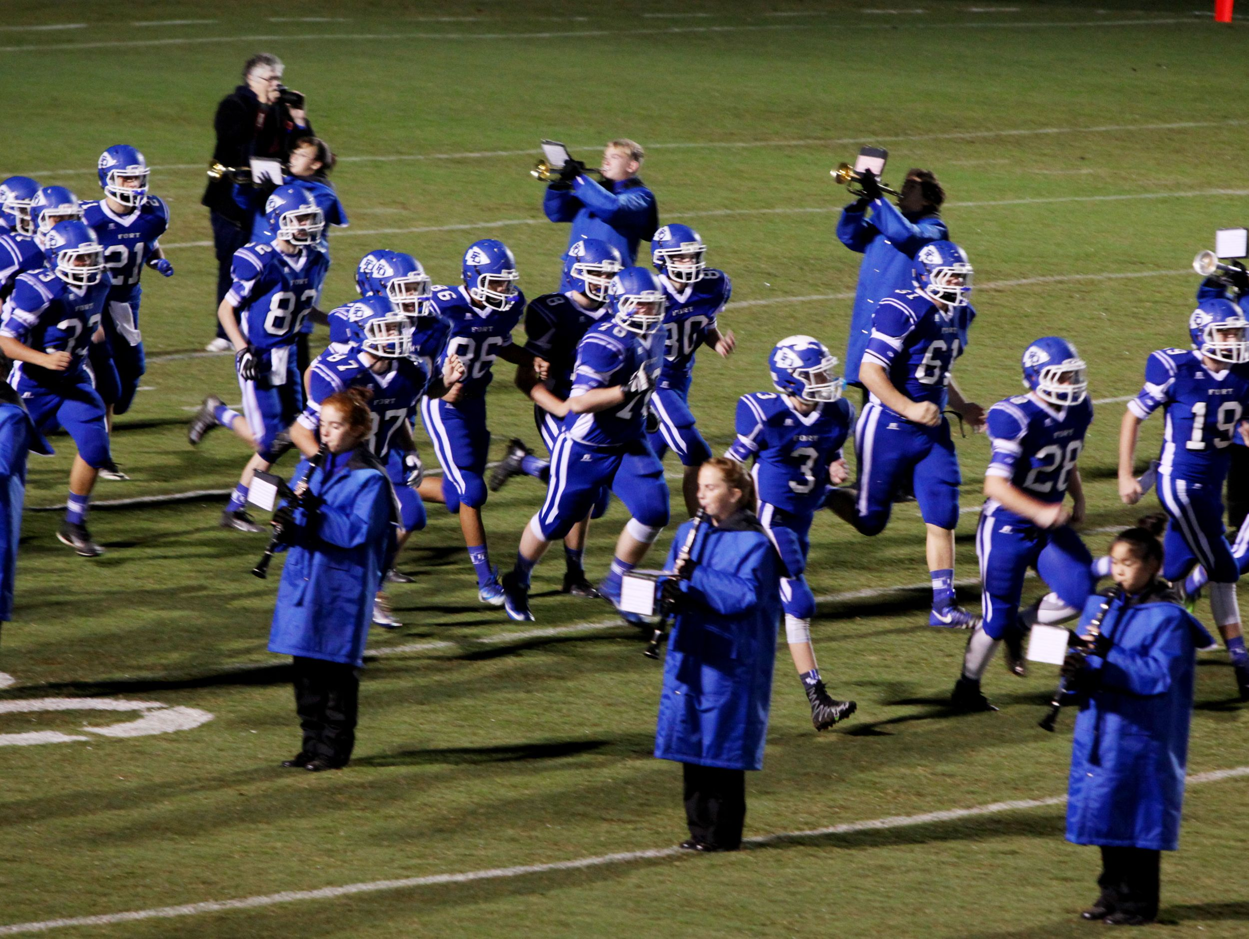 Fort Defiance jogs onto the field during the start of the game against Harrisonburg on Friday, Oct. 21, 2016 at Fort Defiance.