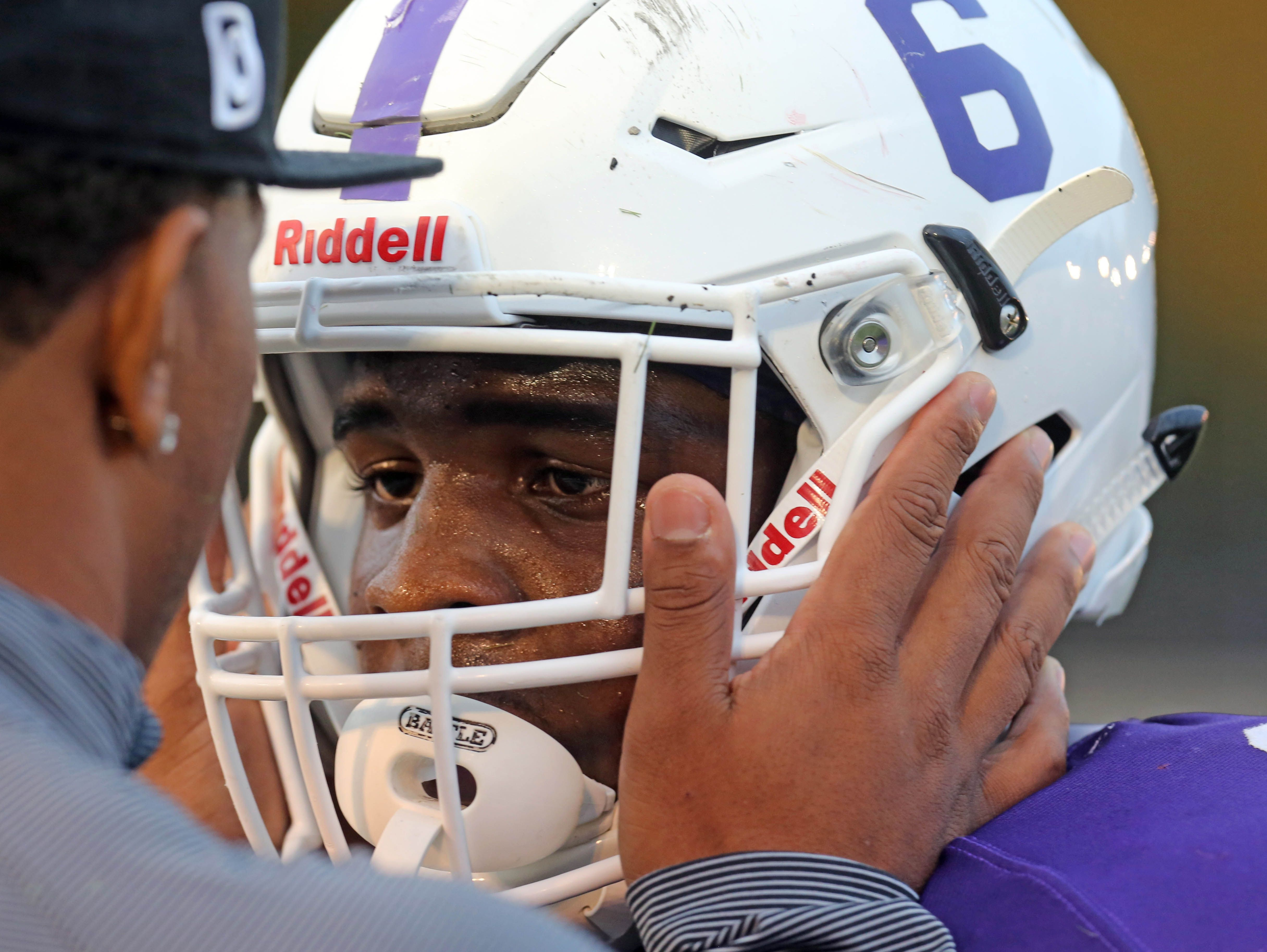 New Rochelle's Jared Baron gets a pep talk from Ray Rice during a Class AA quarterfinal at New Rochelle High School Friday night.