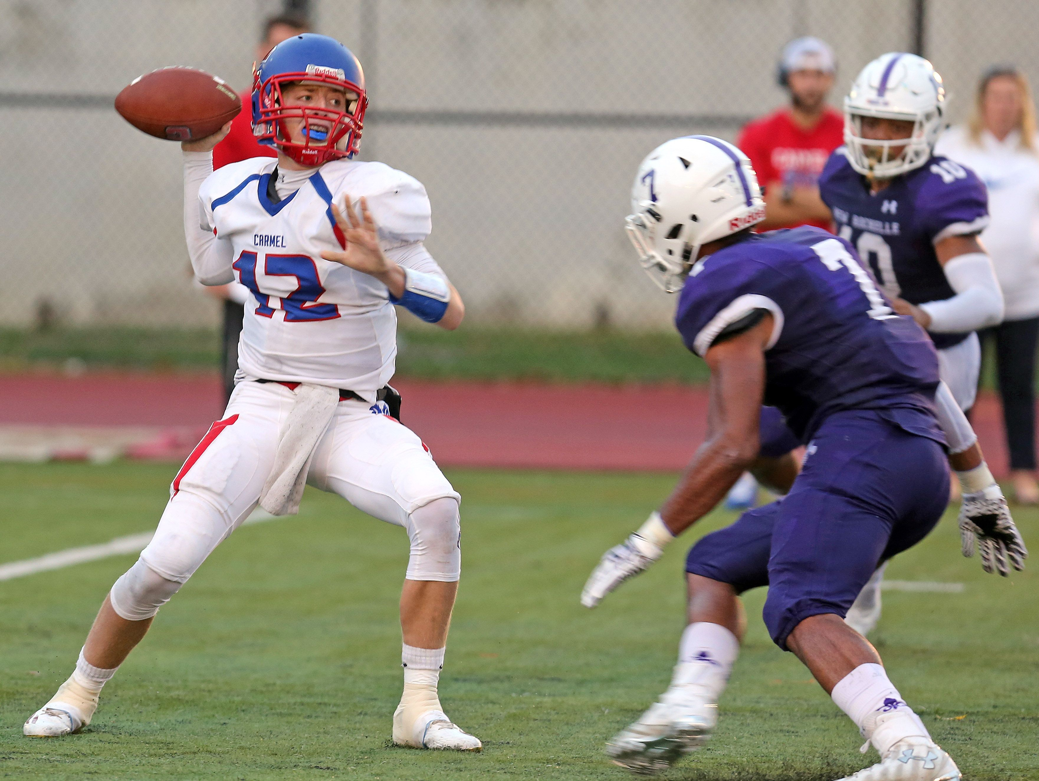Carmel quarterback Kyle Shilling uncorks a pass during a Class AA quarterfinal at New Rochelle High School Friday night. New Rochelle defeated Carmel 6-0.