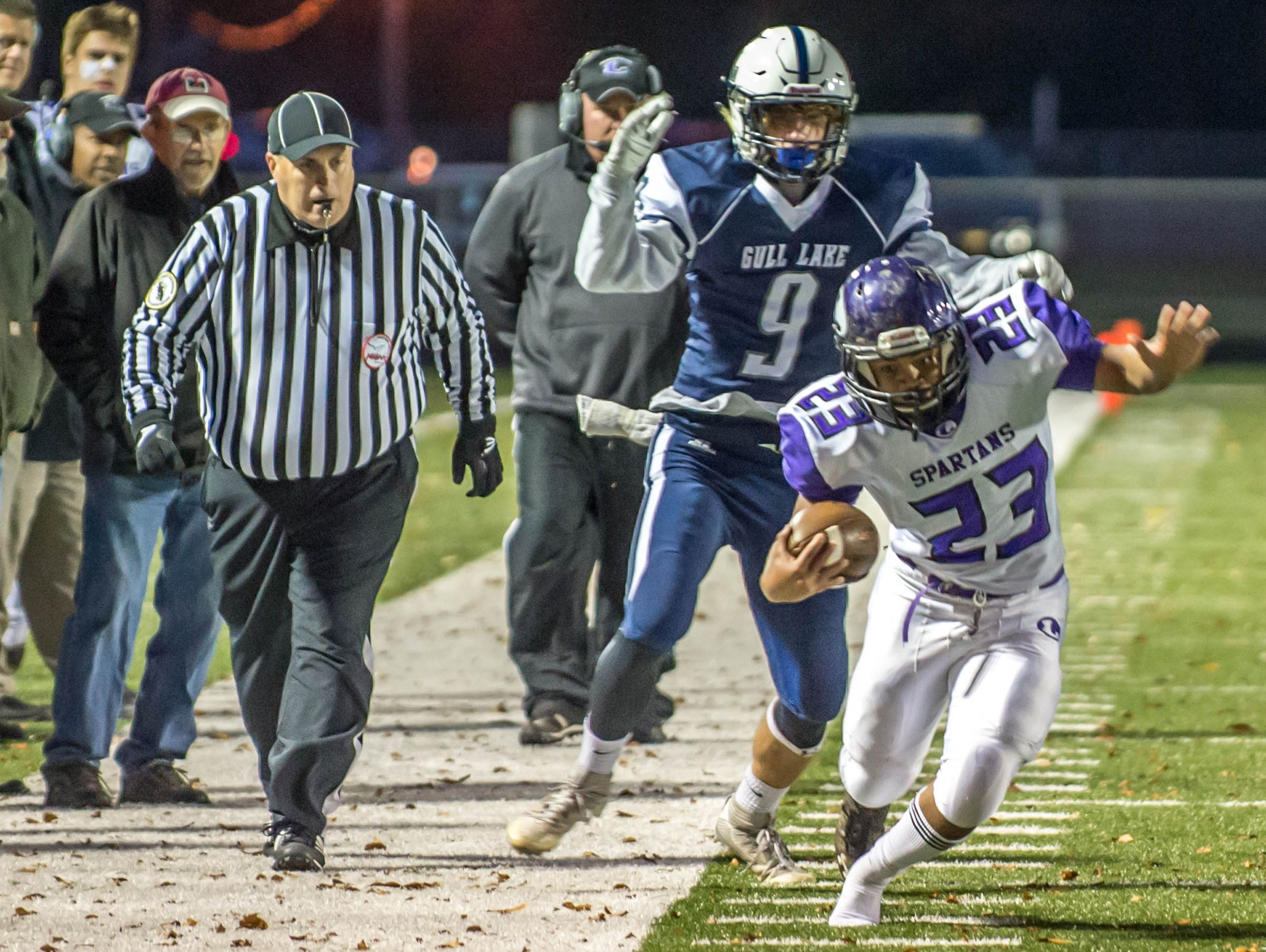 Lakeview's CJ Foster (23) stays inbounds for extra yardage against Gull Lake Friday evening.