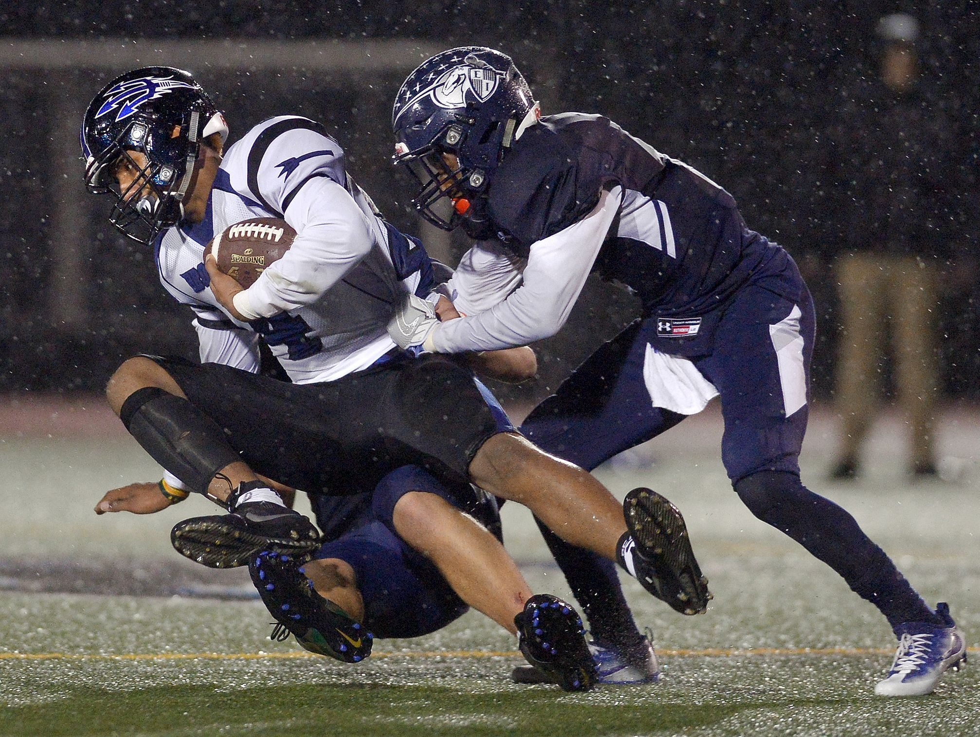Brockport's Raphael Odey is tackled by Eastridge's Bobby Albritton, right, and Jake Trynoski.