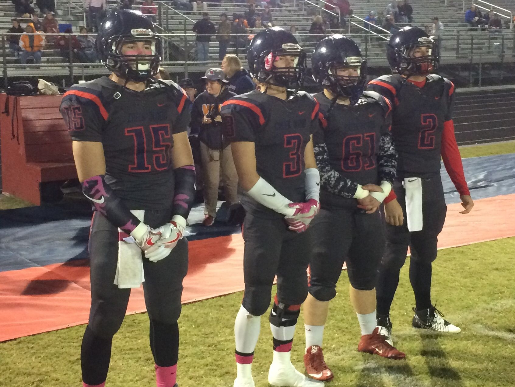 From left, Creek Wood captains Hayden Boone, Brandon Harris, Zach Mayberry, and Devon Higgins before the game against Kenwood.