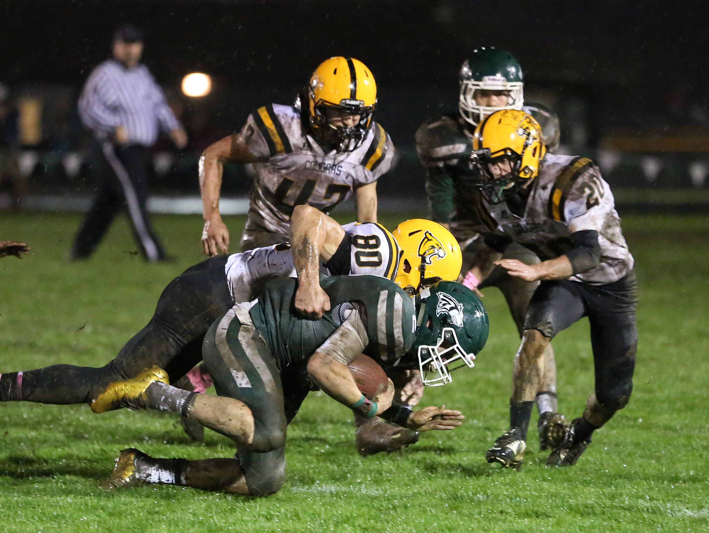Cascade defenders take down North Marion's Boston Snyder as the Cougars defeat North Marion 12-3 in an Oregon West Conference game on Friday, Oct. 21, 2016. Cascade defeats North Marion 12-3 in an Oregon West Conference game on Friday, Oct. 21, 2016.