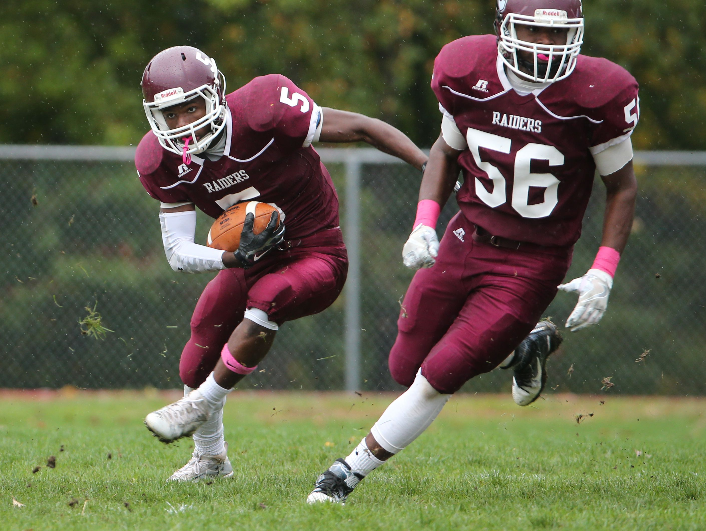 Concord's Lennox Nembhard, No. 5, changes direction as Earl Jester, No. 56, blocks downfield.