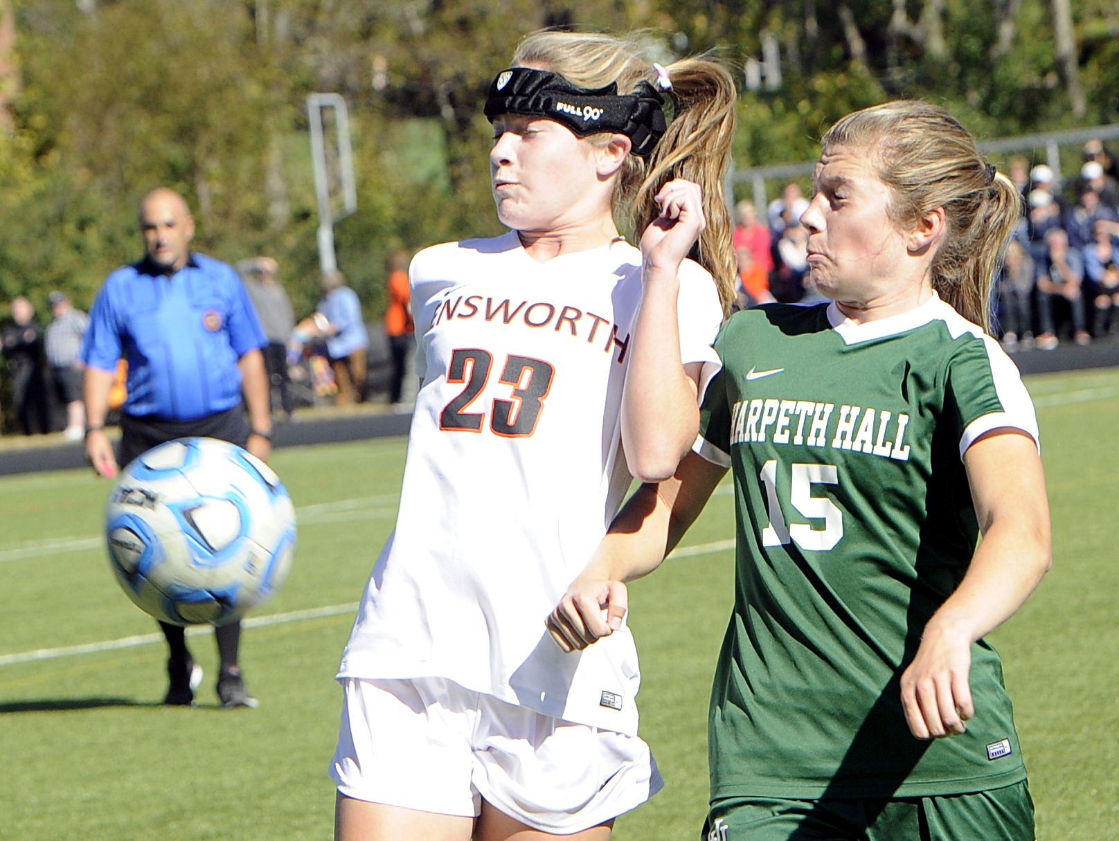 Ensworth sophomore Hailey Braemer and Harpeth Hall senior Lauren Stringfield play a bouncing ball during first-half action on Oct. 22, 2016.