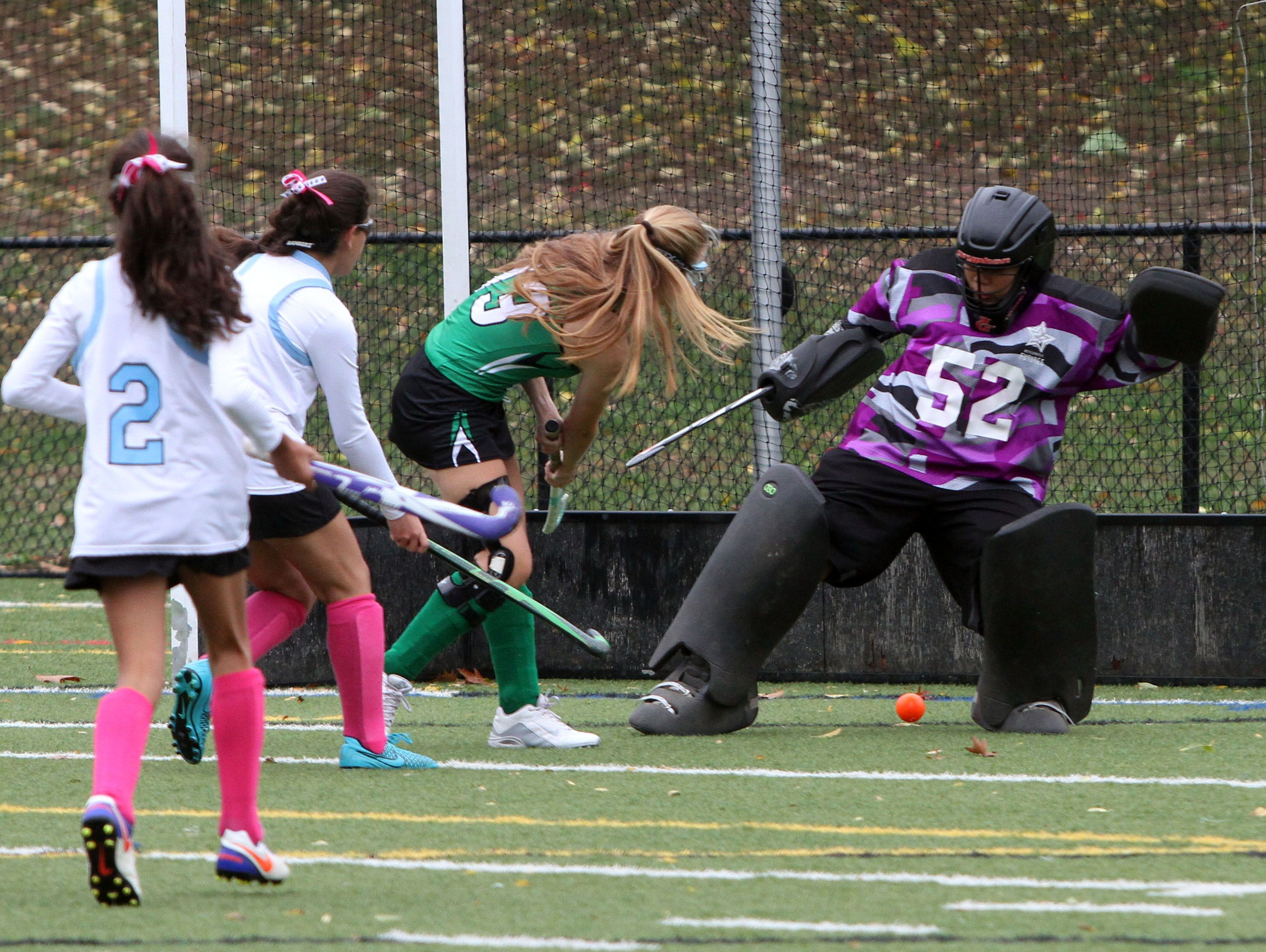 Rye Neck goalie Christina Shin stops a shot by Irvington's Suzanne Carroll during their field hockey game at Mamaroneck High School on Saturday.
