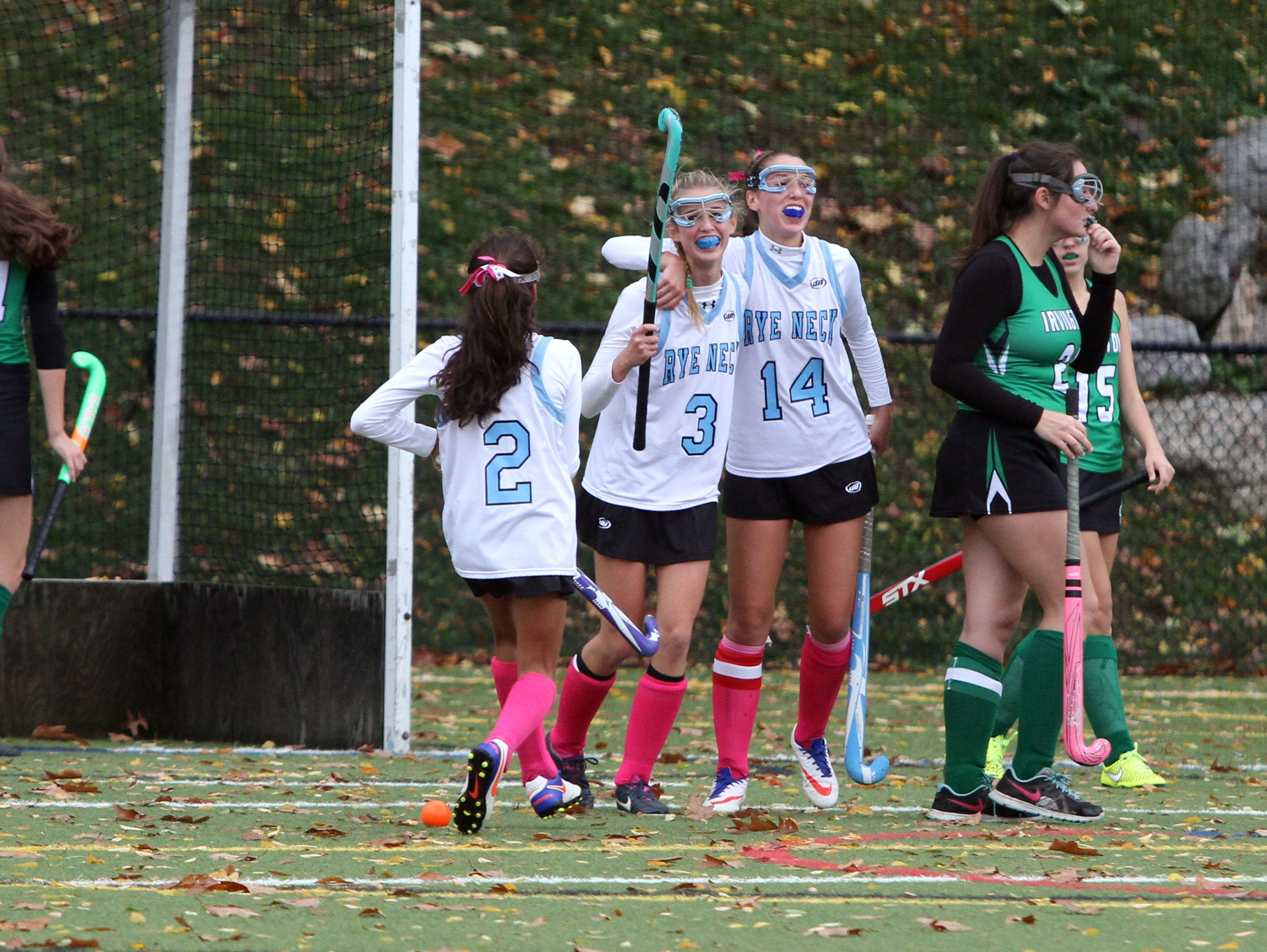 Rye Neck's Sonia Finkenberg, Emilie Cohen and Alison Cohen, celebrate Emilie's goal against Irvington during their field hockey game at Mamaroneck High School Saturday. Rye Neck won 1-0..