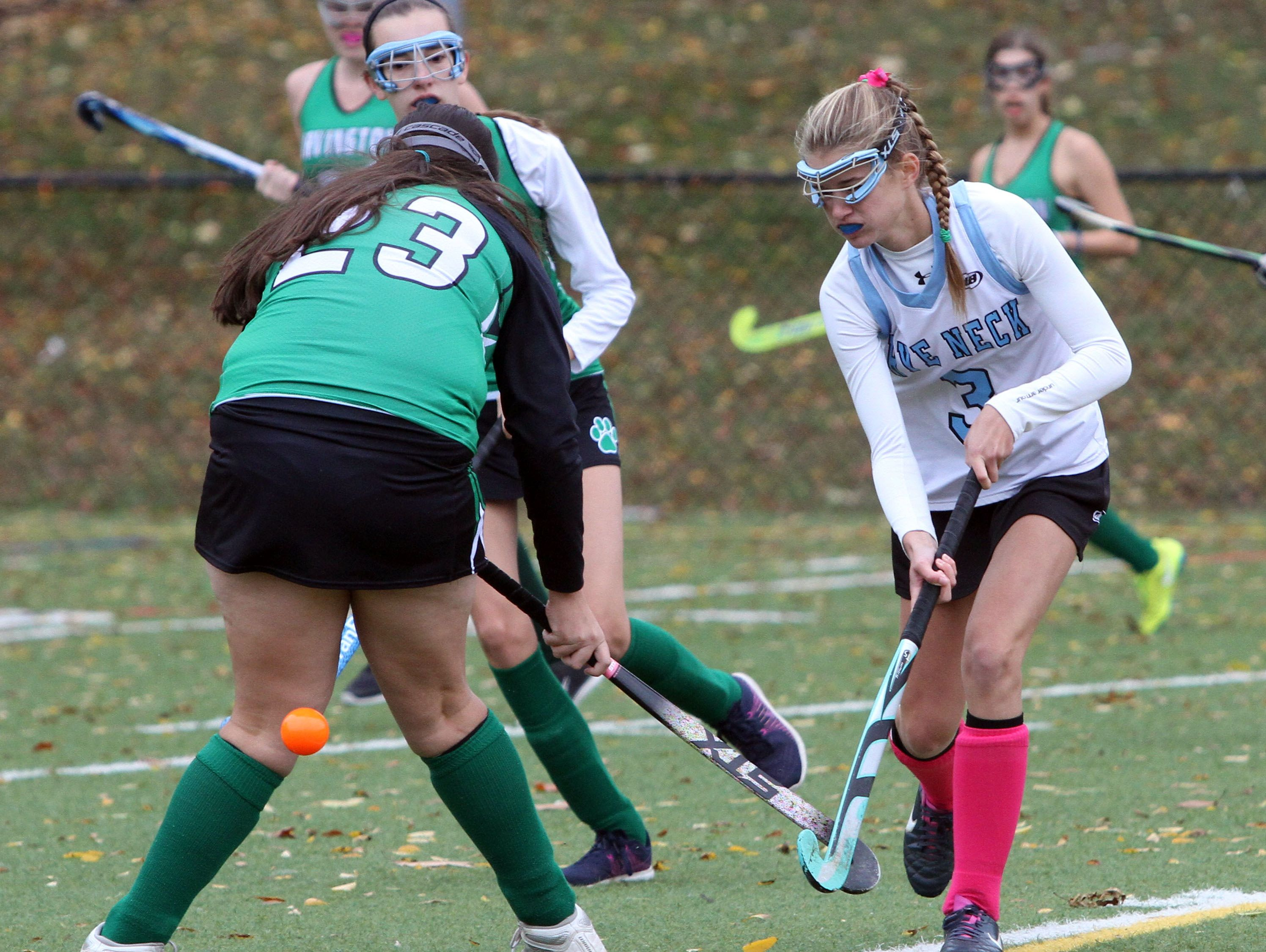 Rye Neck's Emilie Cohen tries to get to the ball behind Irvington's Nicole Sklitsis during their field hockey game at Mamaroneck High School, Oct. 22, 2016.