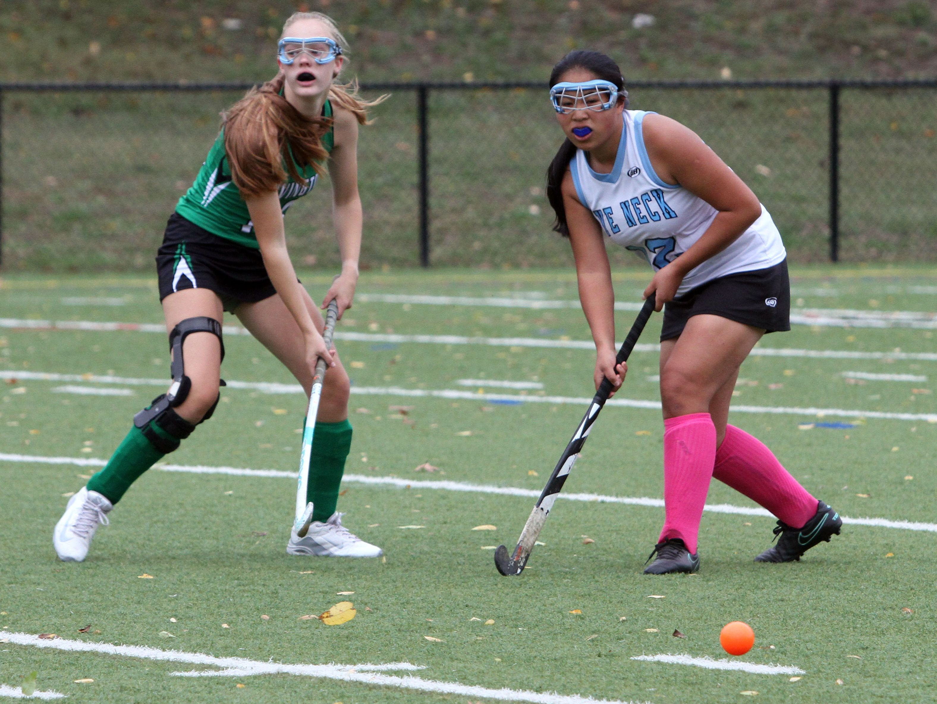 Irvington's Suzanne Carroll and Rye Neck's April Zhang close in on the ball during their game at Mamaroneck High School on Saturday.
