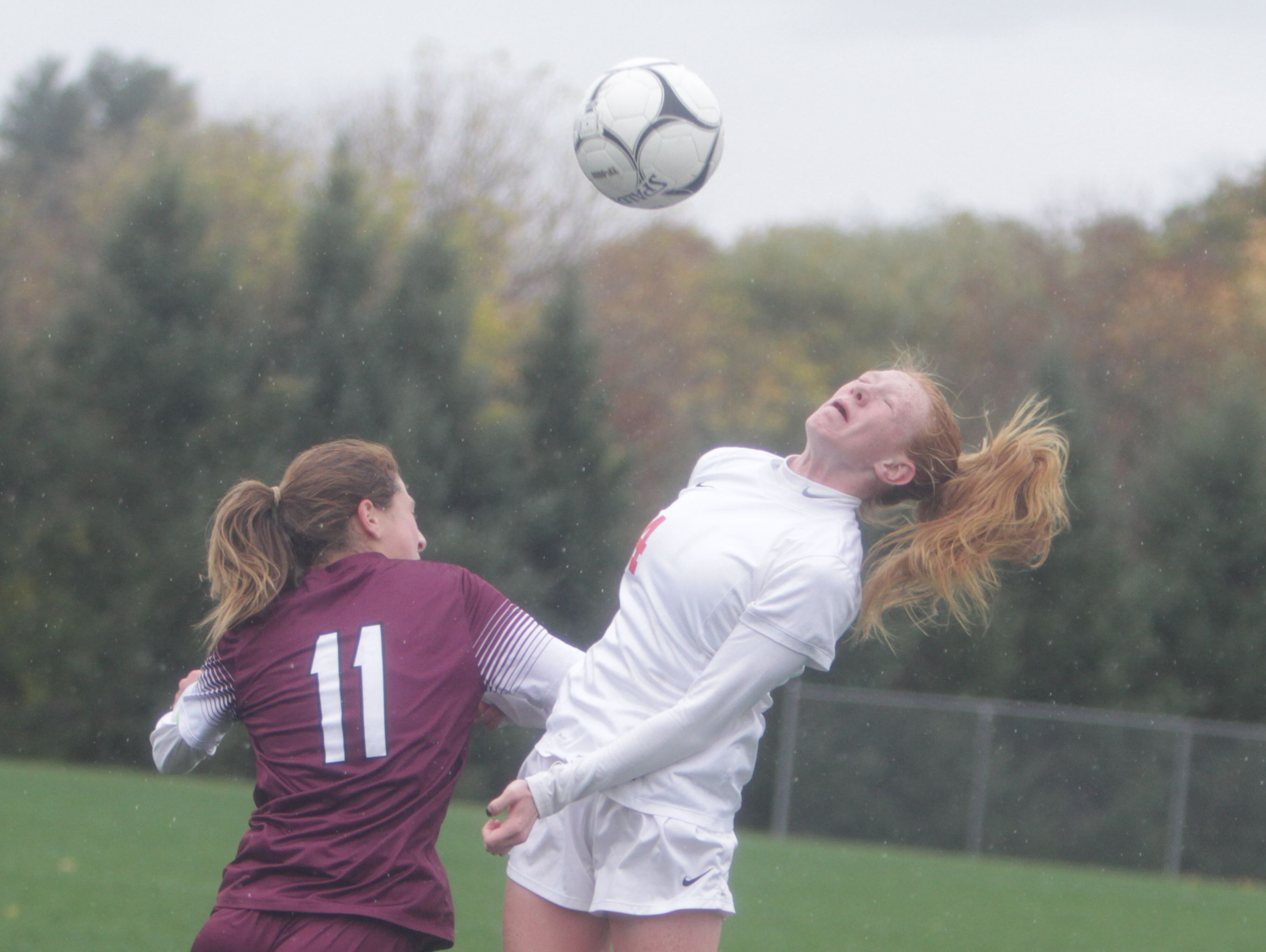 Scarsdale's Hayley Rozencwaig (11) and North Rockland's Kelly Brady (4) both jump for the ball during a Section 1 girls soccer Class AA first round game between North Rockland and Scarsdale at North Rockland High School on Saturday, Oct. 22nd, 2016. North Rockland won 1-0.