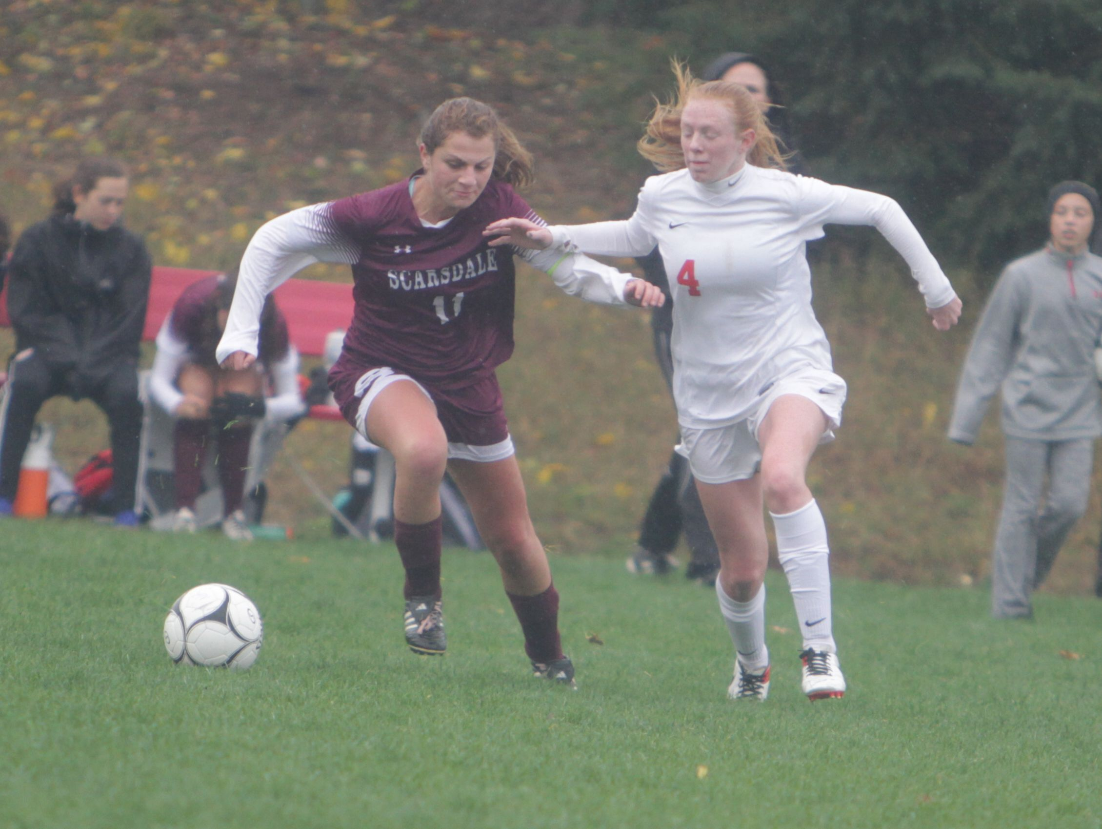Scarsdale's Hayley Rozencwaig (11) and North Rockland's Kelly Brady (4) run after the ball during a Section 1 girls soccer Class AA first round game between North Rockland and Scarsdale at North Rockland High School on Saturday, Oct. 22nd, 2016. North Rockland won 1-0.