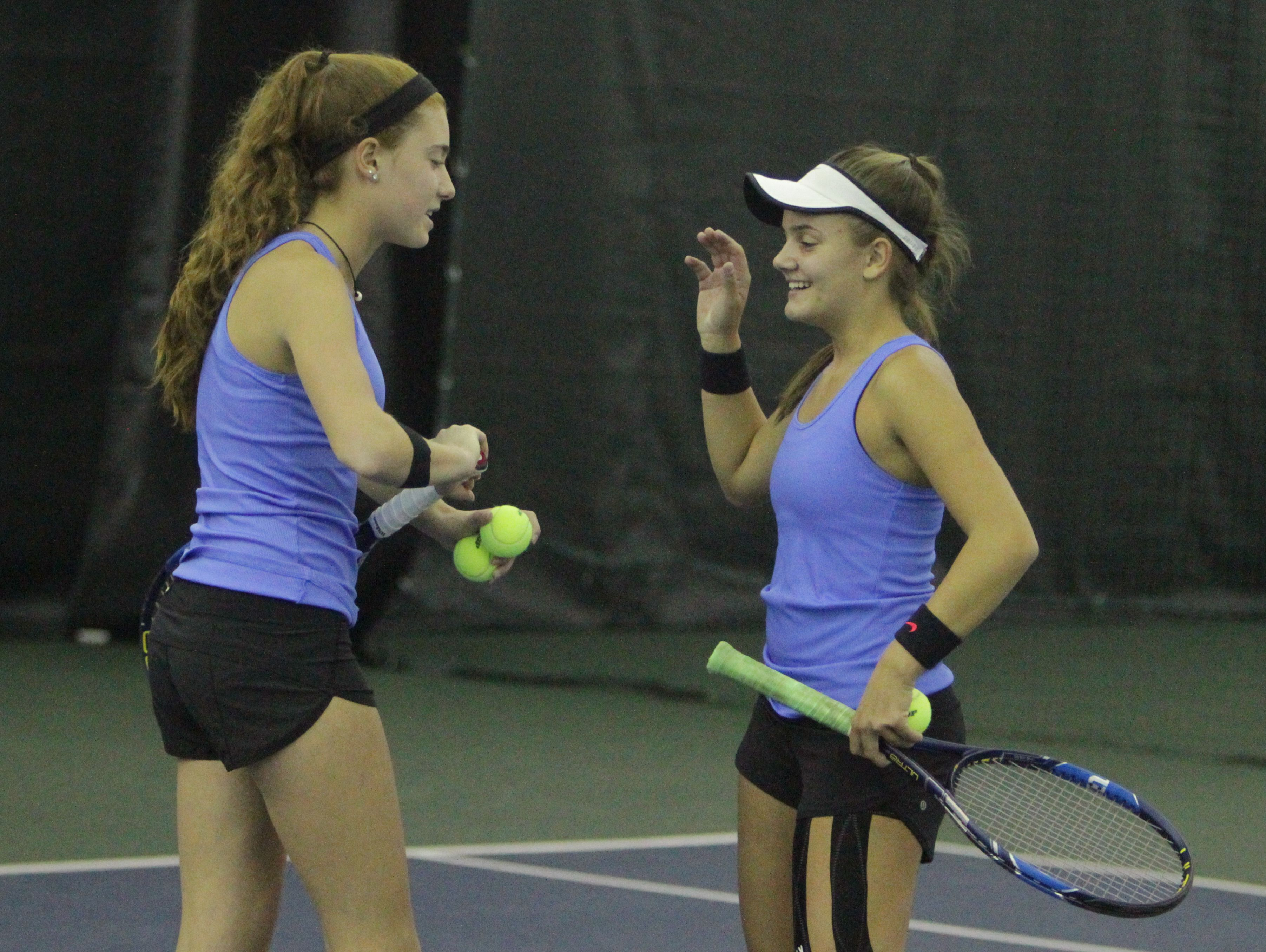 Ursuline's Vanessa Ciano and Laina Campos congratulate each other after winning a point during the 2016 Section 1 Tennis Tournament finals at Sound Shore Indoor Tennis in Port Chester on Sunday, Oct. 23rd, 2016.